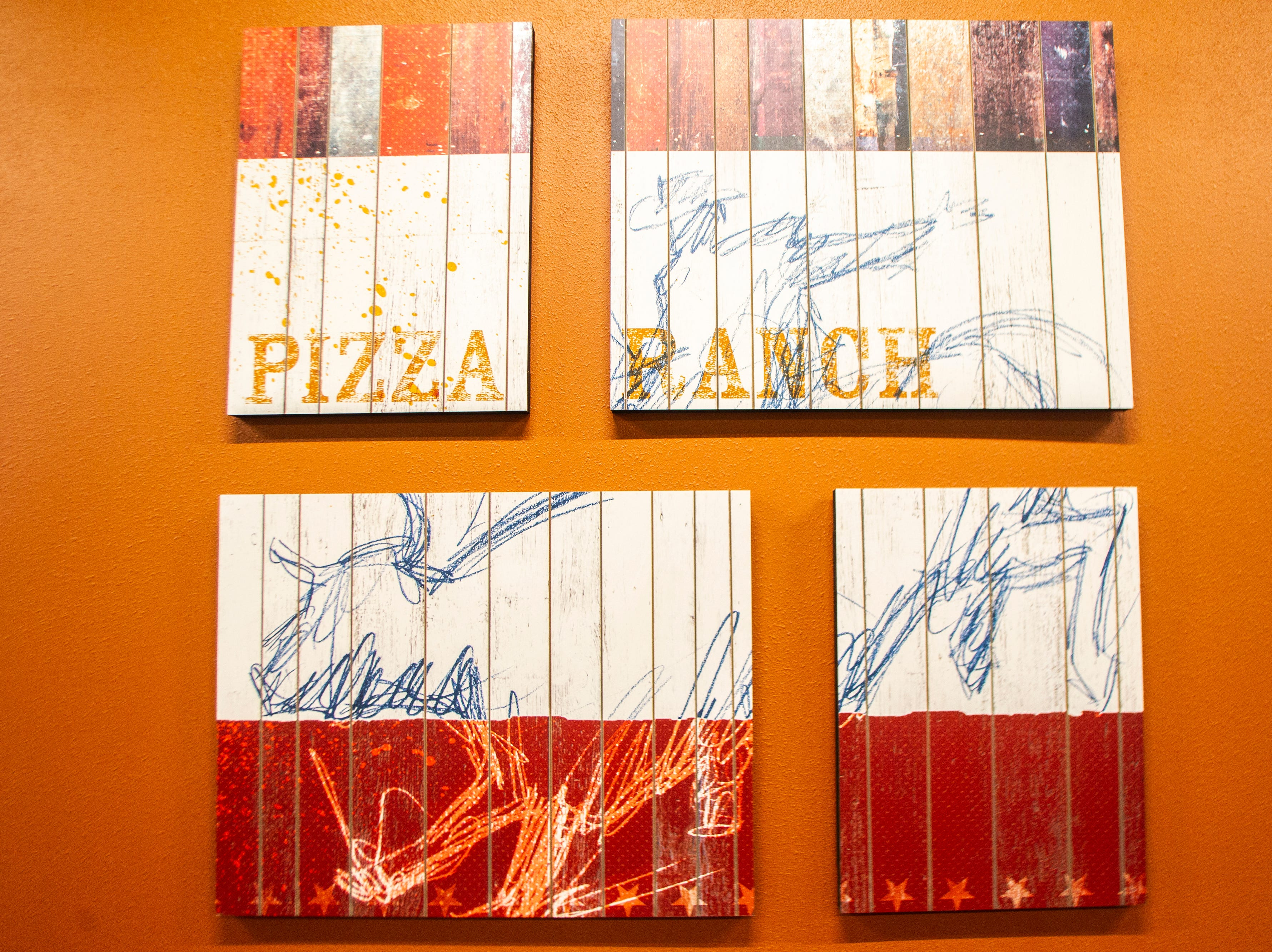 Wall art is seen during a soft opening event on Thursday, Dec. 6, 2018, at Pizza Ranch on Highway 1 West in Iowa City.
