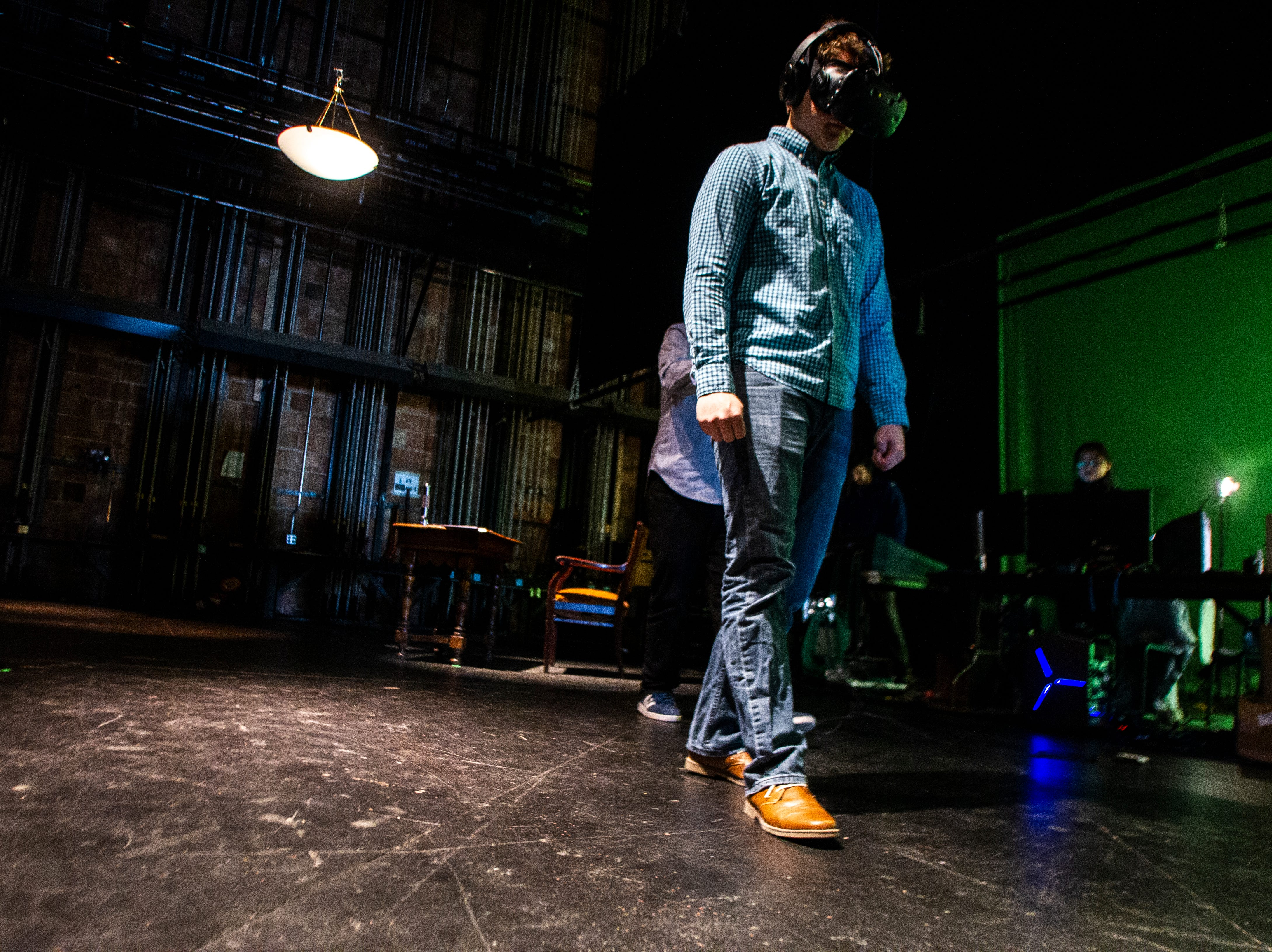 University of Iowa junior Ryan McElroy, majoring in theater with a focus in design, wears a virtual reality headset during a theater performance on Thursday, Dec. 6, 2018, at E.C. Mabie Theater in the UI Theater Building in Iowa City. McElroy is the sound designer for the production.