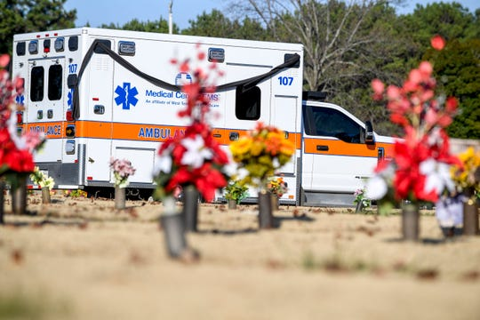 The ambulance carrying the body of Zach Pruitt arrives at Highland Memorial Gardens in Jackson, Tenn., on Wednesday, Dec. 5, 2018.