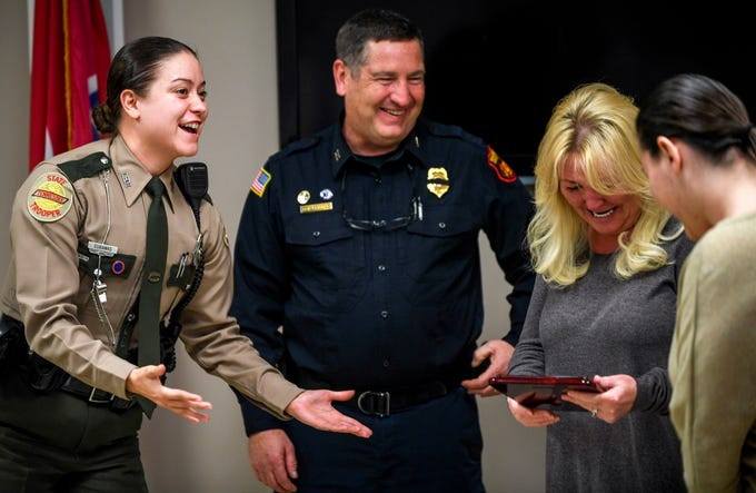 THP Trooper Jena Eubanks, left, and fire marshal Don Friddle, center, present the Safe Kids Person of the Year award to Kylee Jo Lam, right, at Madison County Fire Department in Jackson, Tenn., on Thursday, Dec. 6, 2018.