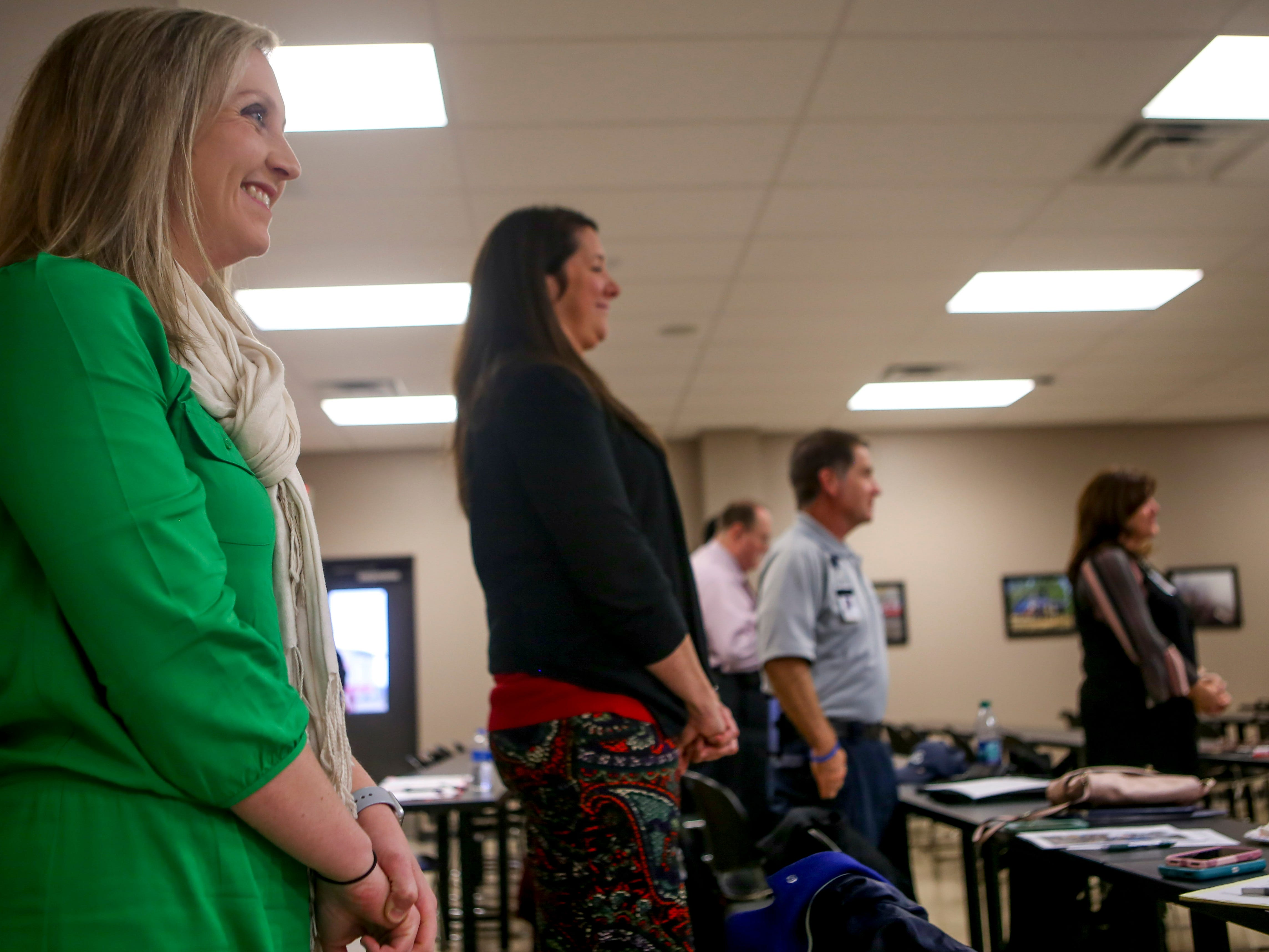 Attendees watch their friend Kylee Jo Lam be presented the Safe Kids Person of the Year award at Madison County Fire Department in Jackson, Tenn., on Thursday, Dec. 6, 2018.