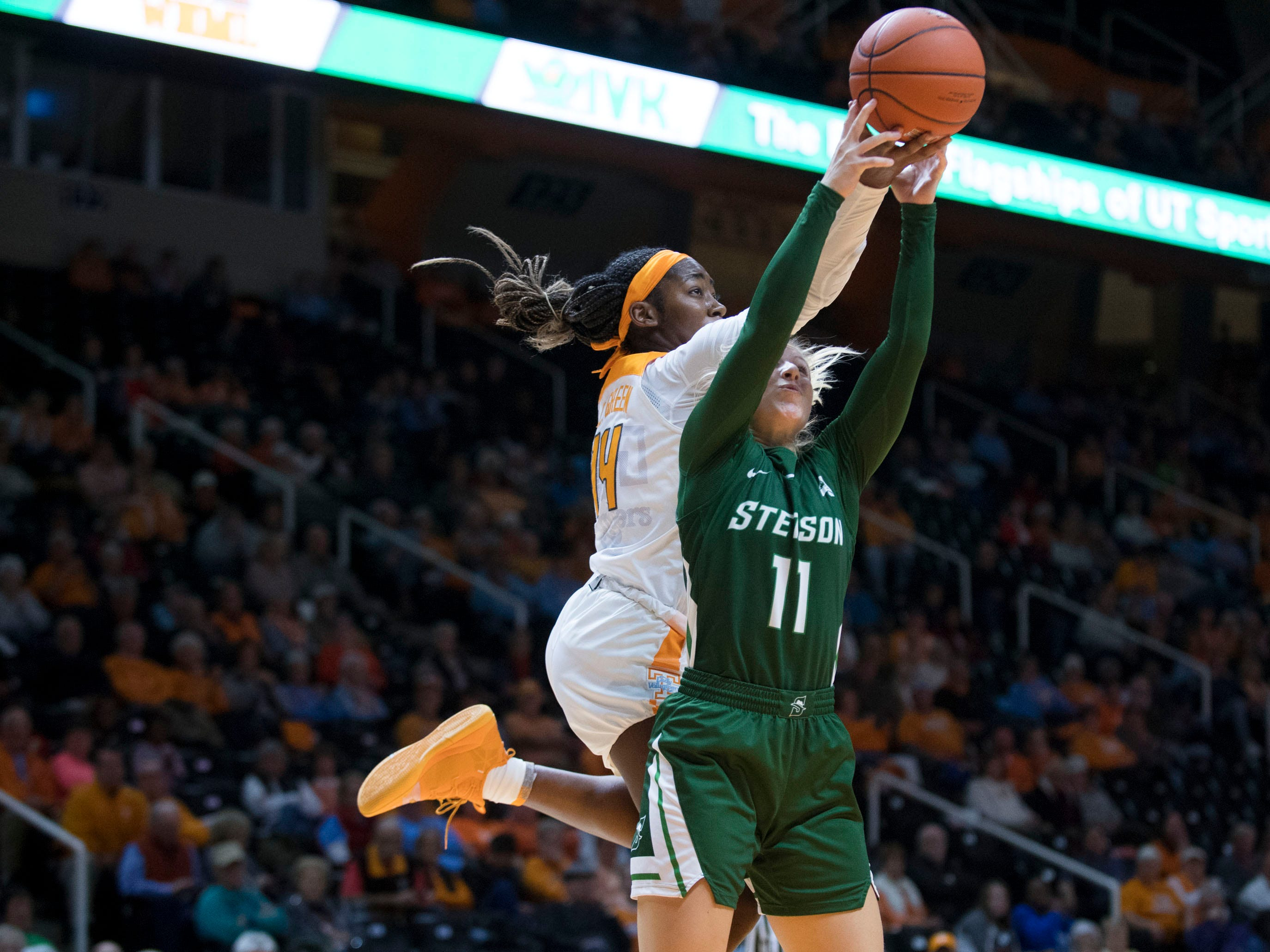 Tennessee's Zaay Green (14) tries to get the rebound over Stetson's Addi Walters (11) on Wednesday, December 5, 2018.