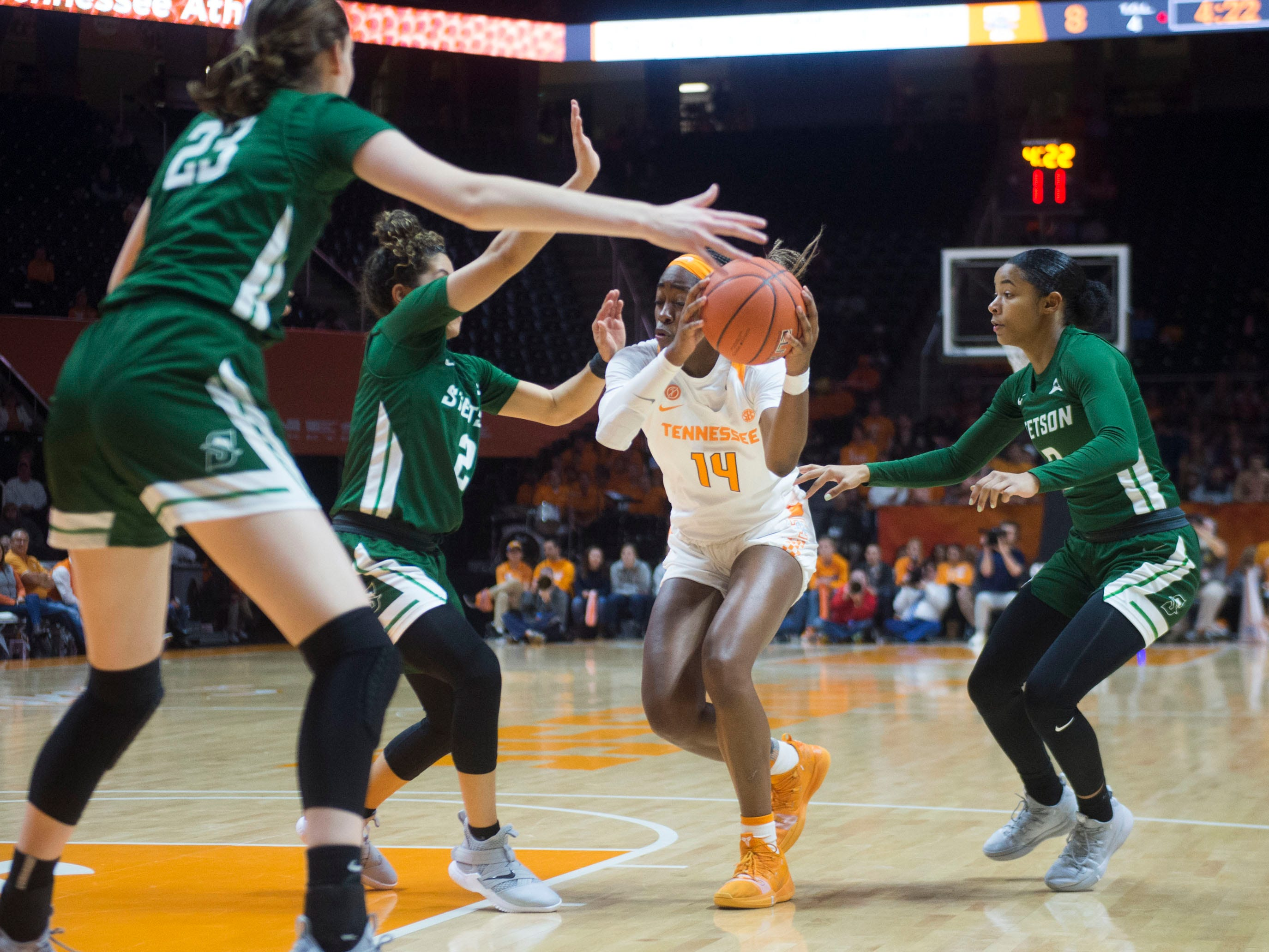Tennessee's Zaay Green (14) tries to get to the basket through Stetson defenders at Thompson-Boling Arena on Wednesday, December 5, 2018.