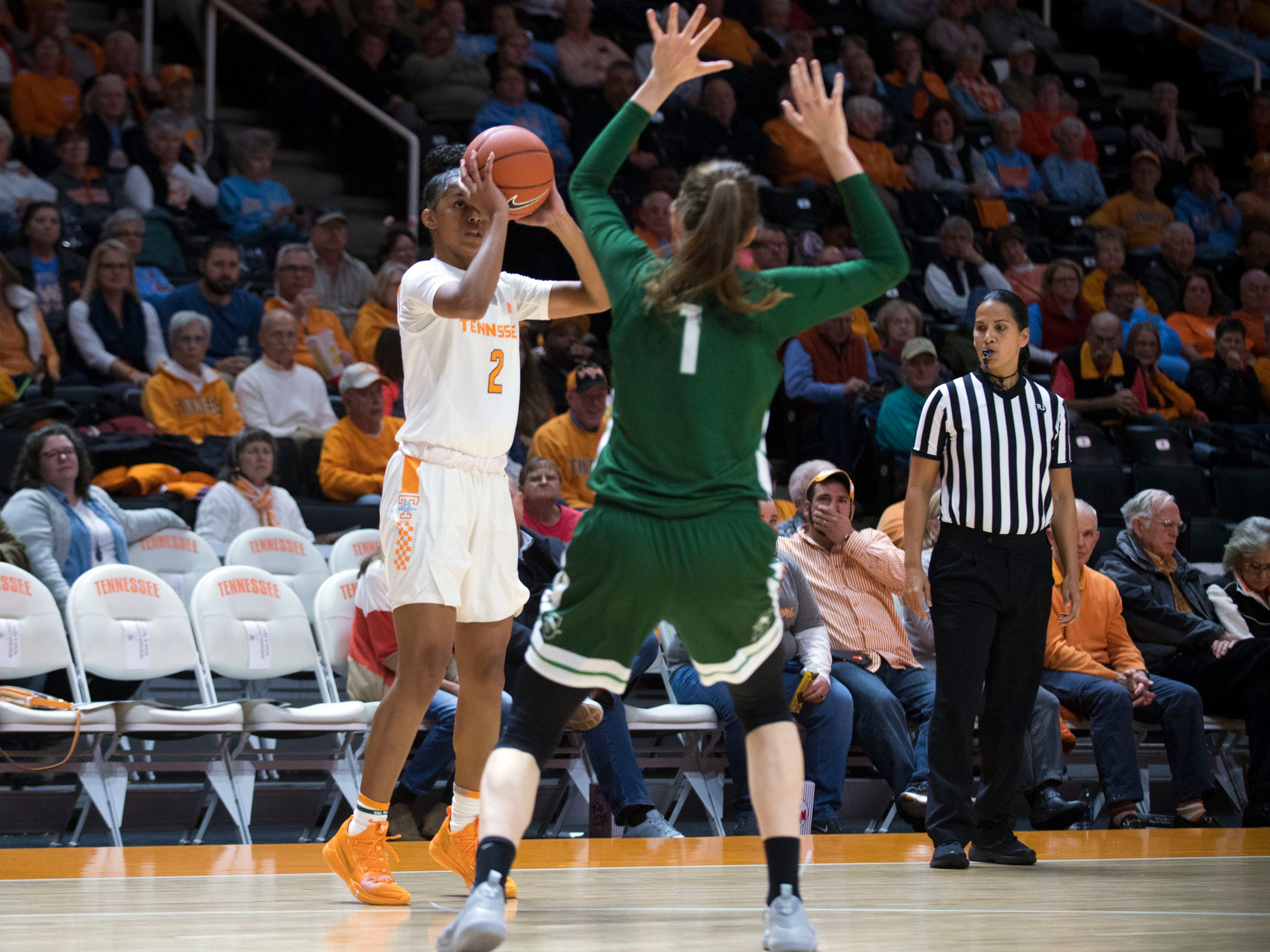 Tennessee's Evina Westbrook (2) on a three-point attempt while guarded by Stetson's Sarah Sagerer (1) at Thompson-Boling Arena on Wednesday, December 5, 2018.