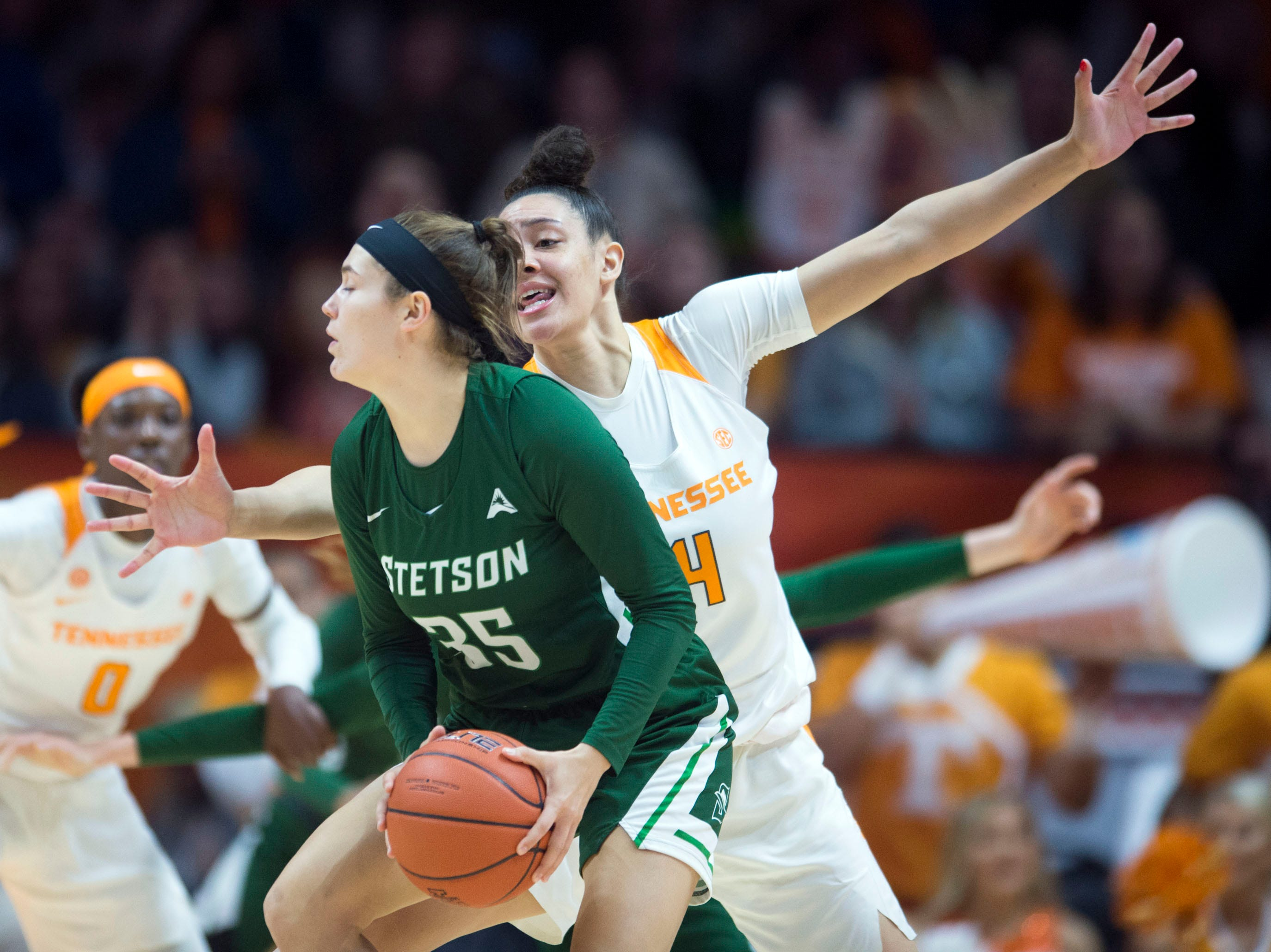 Tennessee's Mimi Collins (4) defends Stetson's Kendall Lentz (35) at Thompson-Boling Arena on Wednesday, December 5, 2018.
