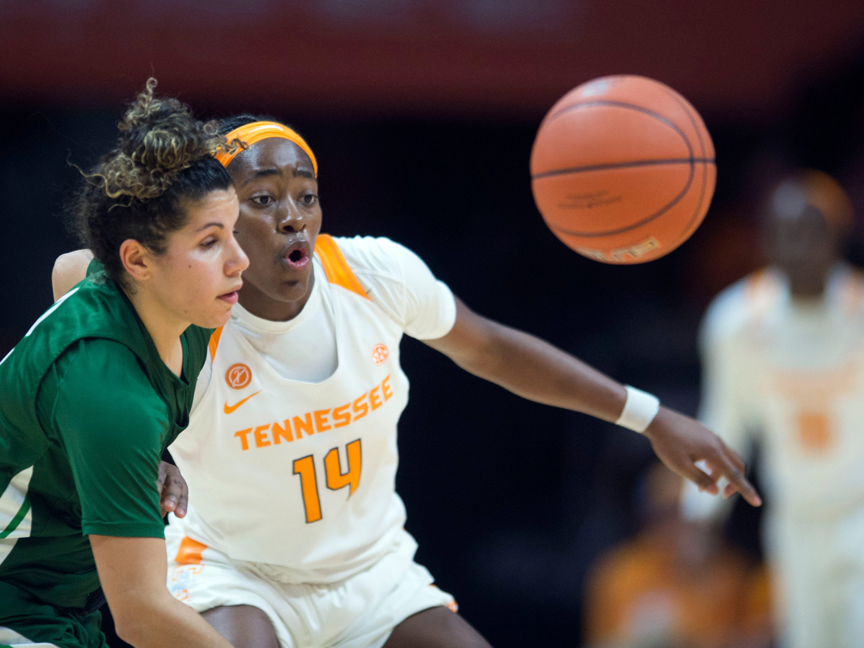 Tennessee's Zaay Green (14) and Stetson's McKenna Beach (2) chase after the ball at Thompson-Boling Arena on Wednesday, December 5, 2018.