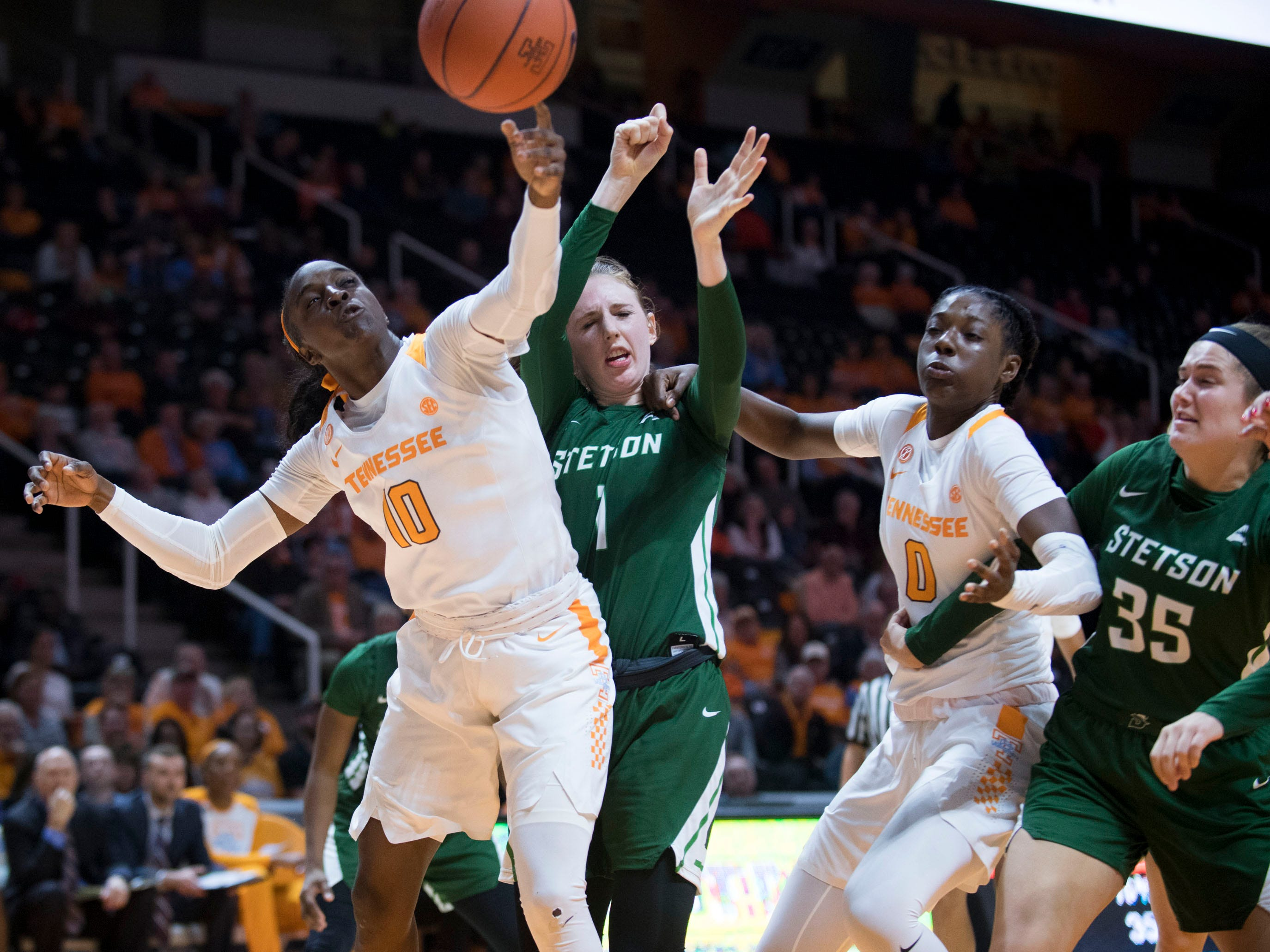 Tennessee's Meme Jackson (10) her hand on the rebound over Stetson's Sarah Sagerer (1) at Thompson-Boling Arena on Wednesday, December 5, 2018.