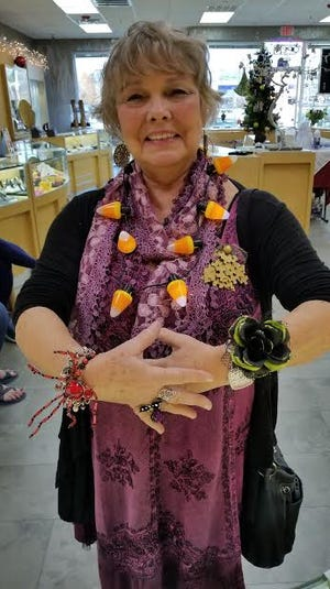 First place went to Shirley for her Halloween jewelry.  The pin she is wearing is made from puzzle pieces.  Winners received gift cards from the store.