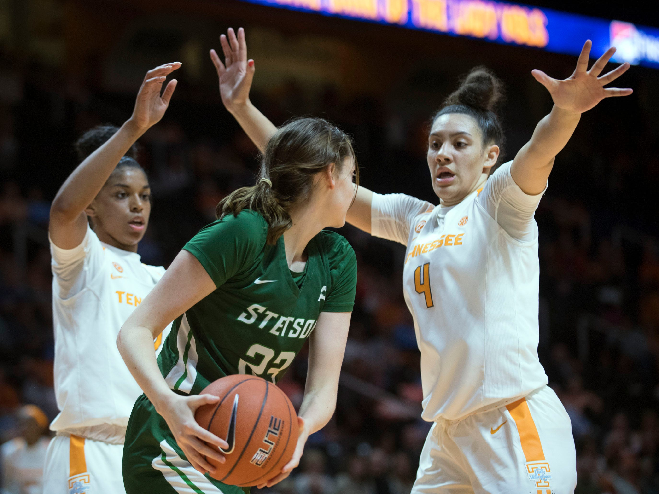 Tennessee's Megan Vincent (23) comes up gainst Tennessee's Evina Westbrook (2) and Mimi Collins (4) on Wednesday, December 5, 2018.