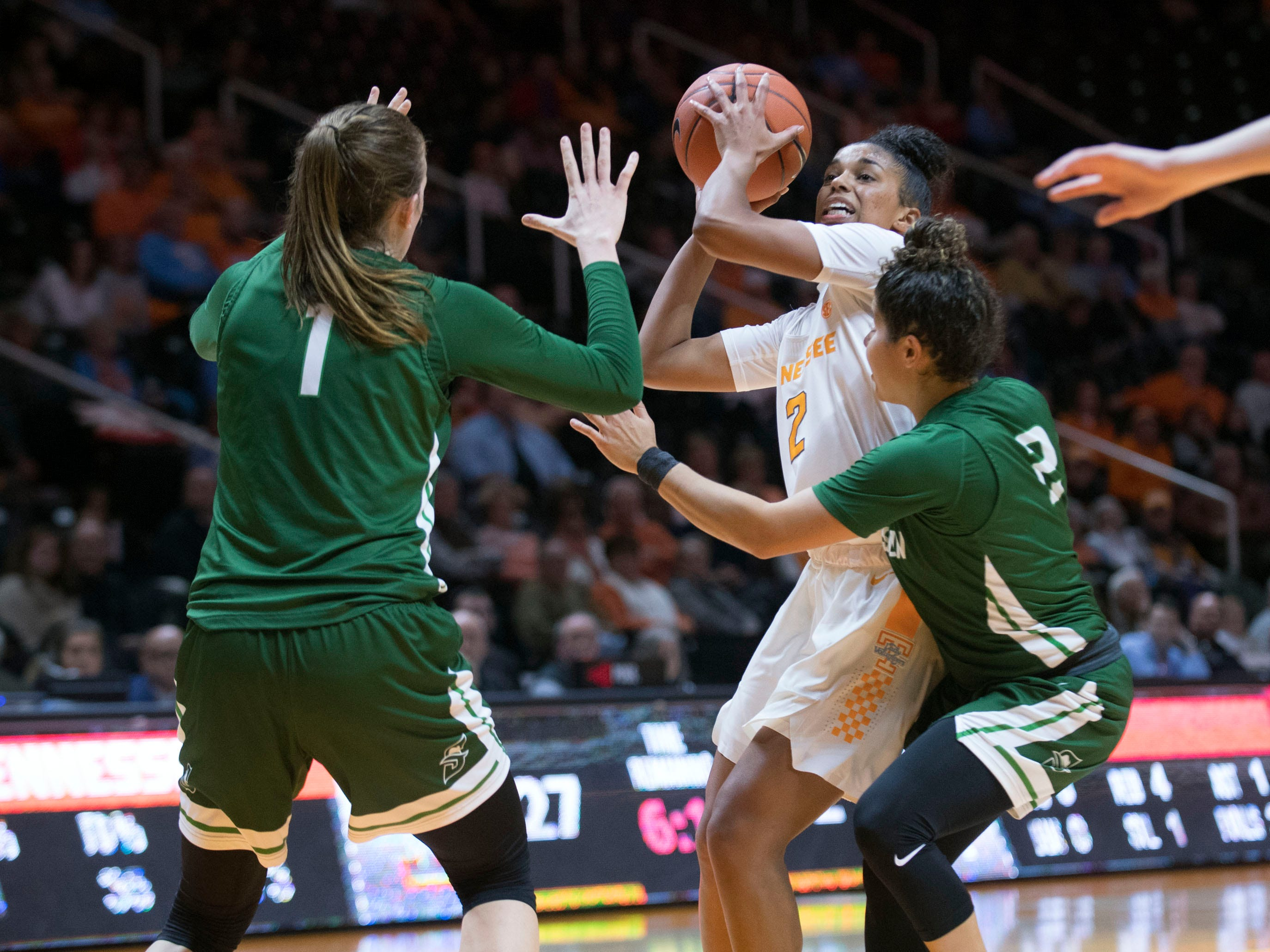 Tennessee's Evina Westbrook (2) attempts to score while defended by Stetson's Sarah Sagerer (1) and McKenna Beach (2) on Wednesday, December 5, 2018.