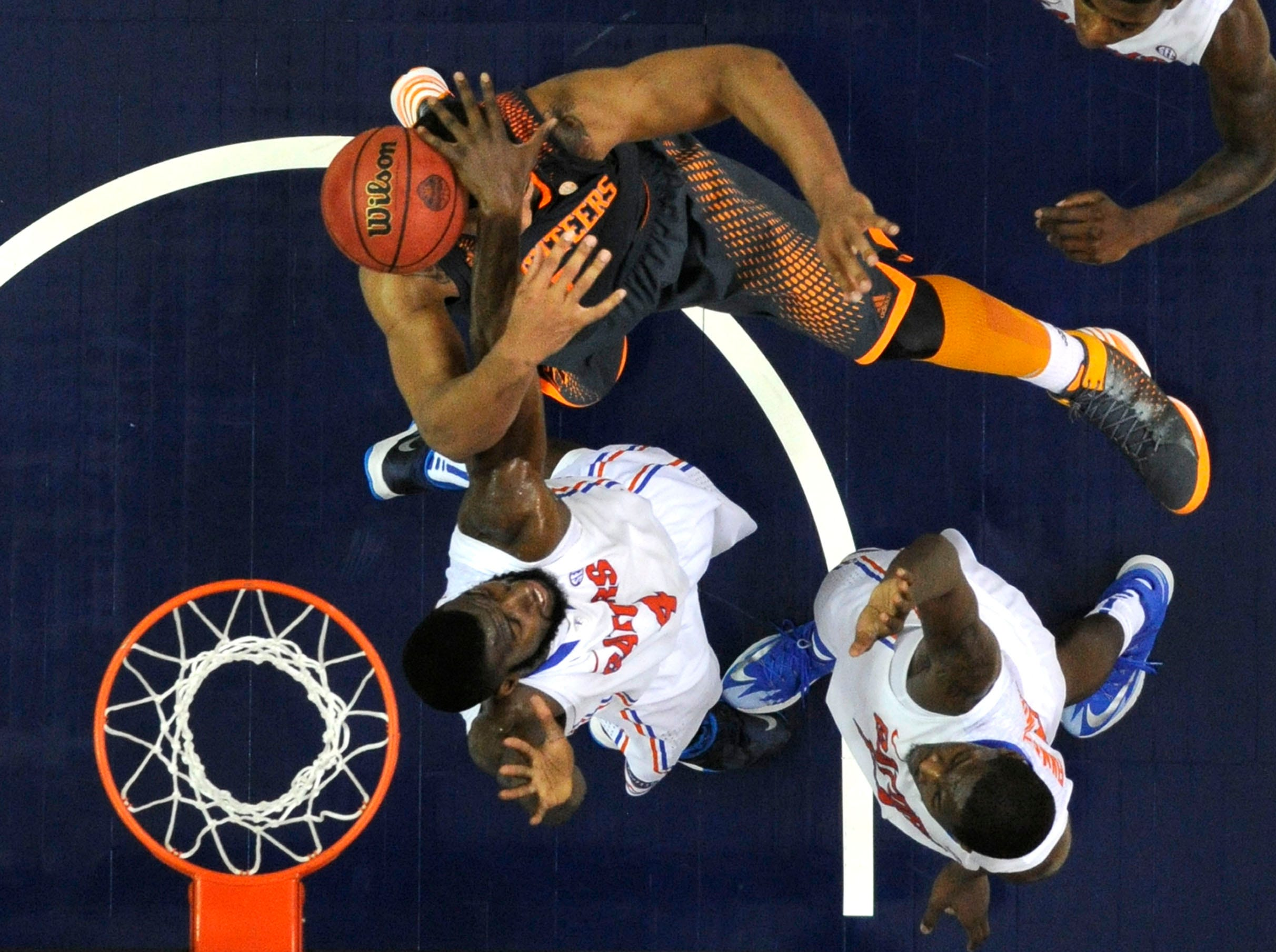 Tennessee forward Jarnell Stokes (5) is hit in the face while attempting a layup against Florida center Patric Young (4) during the second half of an SEC tournament semifinal game at the Georgia Dome in Atlanta on Saturday, March 15, 2014. Tennessee lost 56-49.