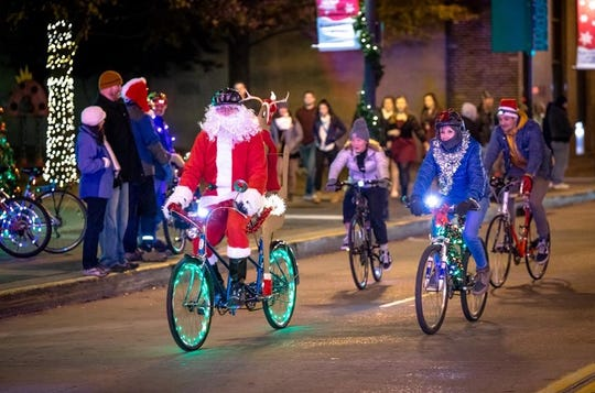 Kent and wife Laura, a graphic designer (in blue), at the 2017 Tour de Lights. Dec. 15, 2017.