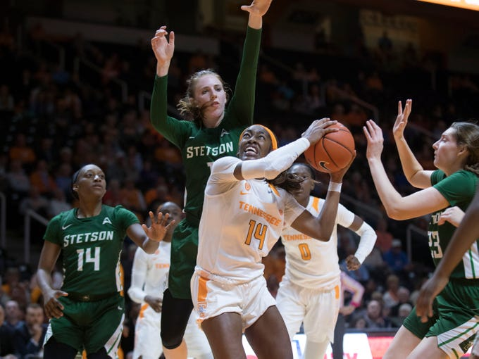 Tennessee's Zaay Green (14) looks for an open shot while defended by Stetson's Sarah Sagerer (1) on Wednesday, December 5, 2018.