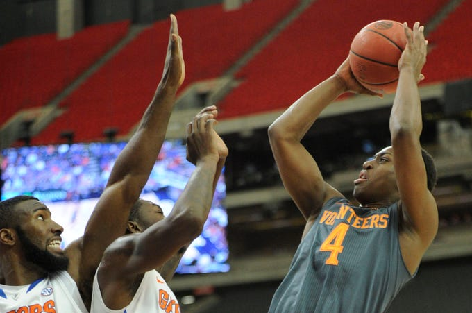 Tennessee guard Armani Moore (4) attempts a shot against Florida defense during the first half of an SEC tournament semifinal game at the Georgia Dome in Atlanta on Saturday, March 15, 2014.