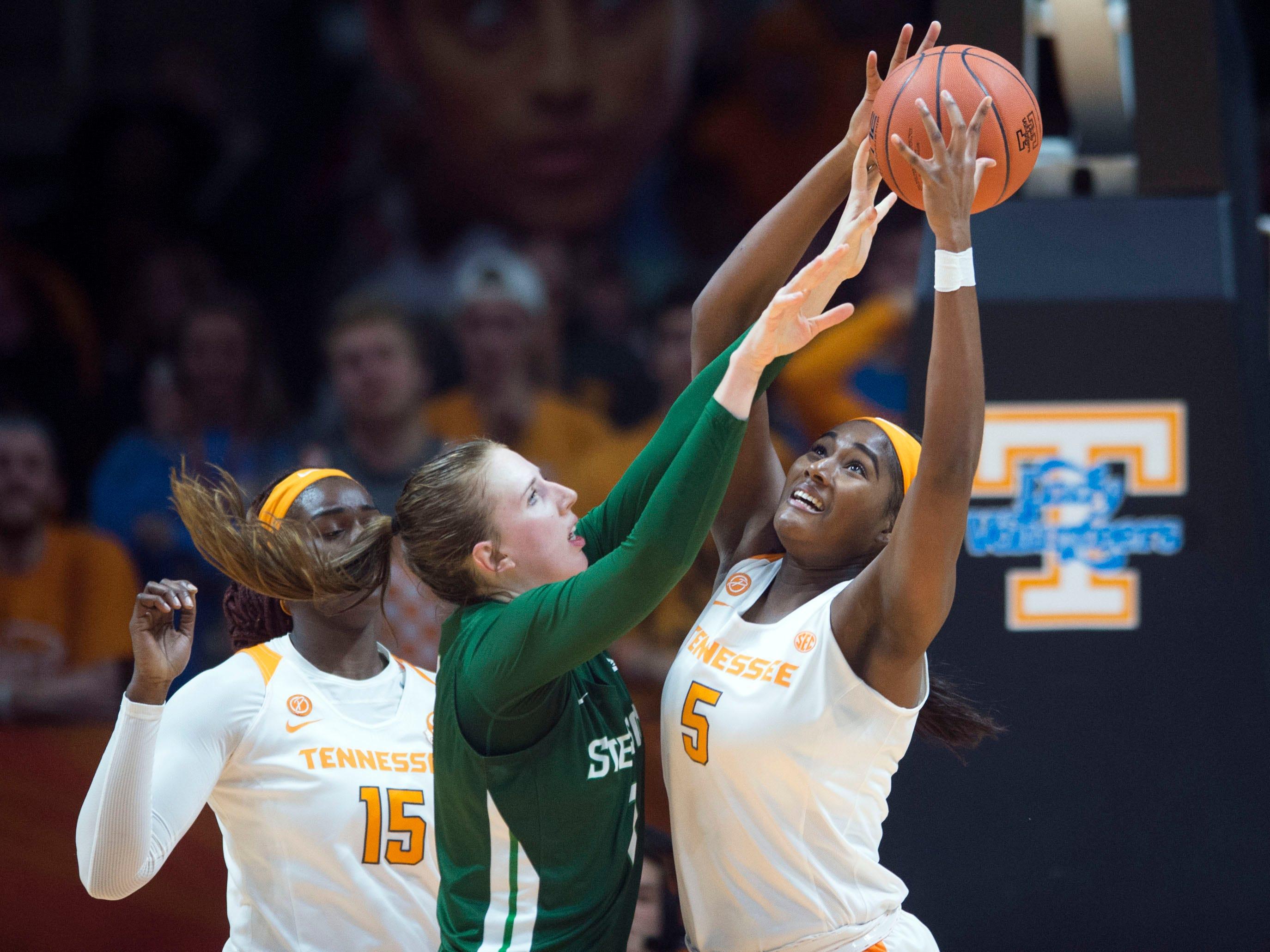 Tennessee's Kamera Harris (5) gets the rebound over Stetson's Sarah Sagerer (1) on Wednesday, December 5, 2018.