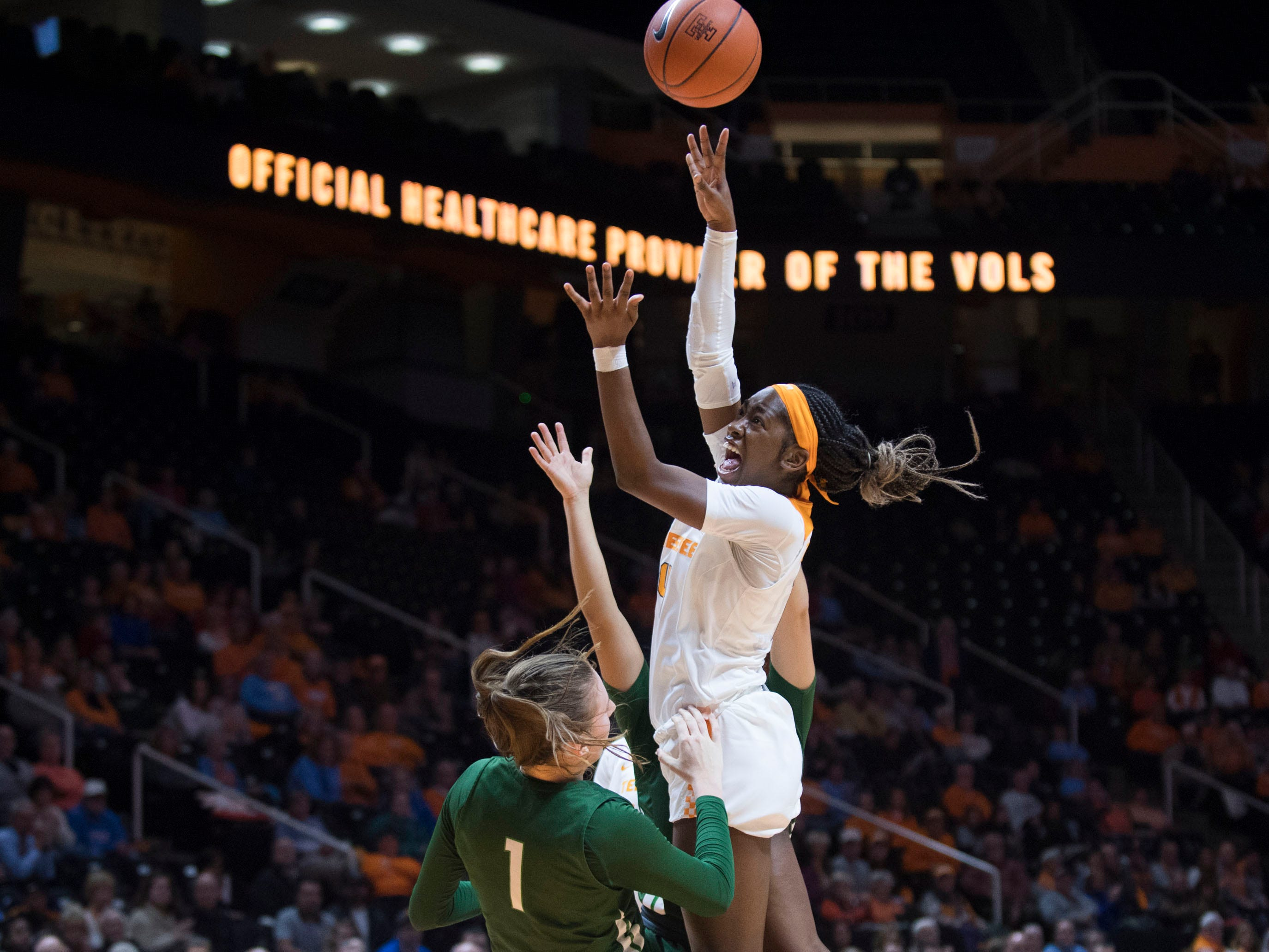 Tennessee's Zaay Green (14) attempts to score while defended by Stetson's Sarah Sagerer (1) at Thompson-Boling Arena on Wednesday, December 5, 2018.