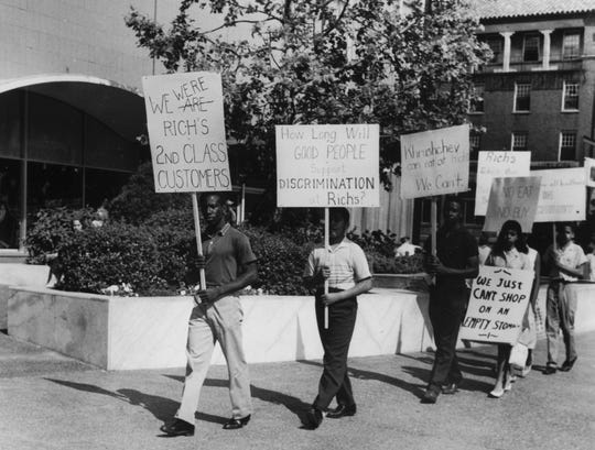 A demonstration against segregated lunch counters June 27, 1960 at Rich's department store on Henley Street. (News Sentinel Archive)