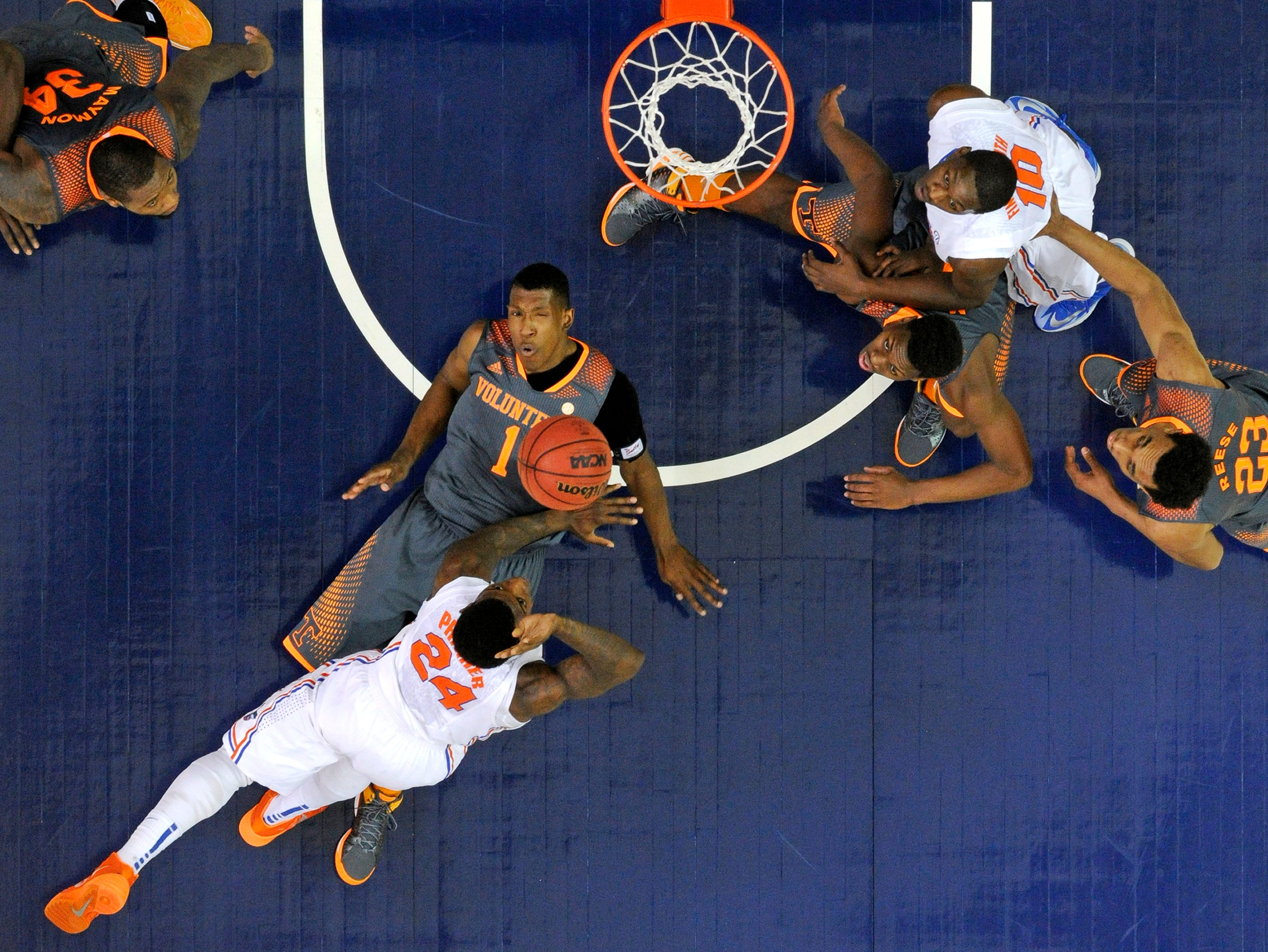 Tennessee guard Josh Richardson (1) draws a charging foul from Florida forward Casey Prather (24) during the first half of an SEC tournament semifinal game at the Georgia Dome in Atlanta on Saturday, March 15, 2014. Tennessee lost 56-49.