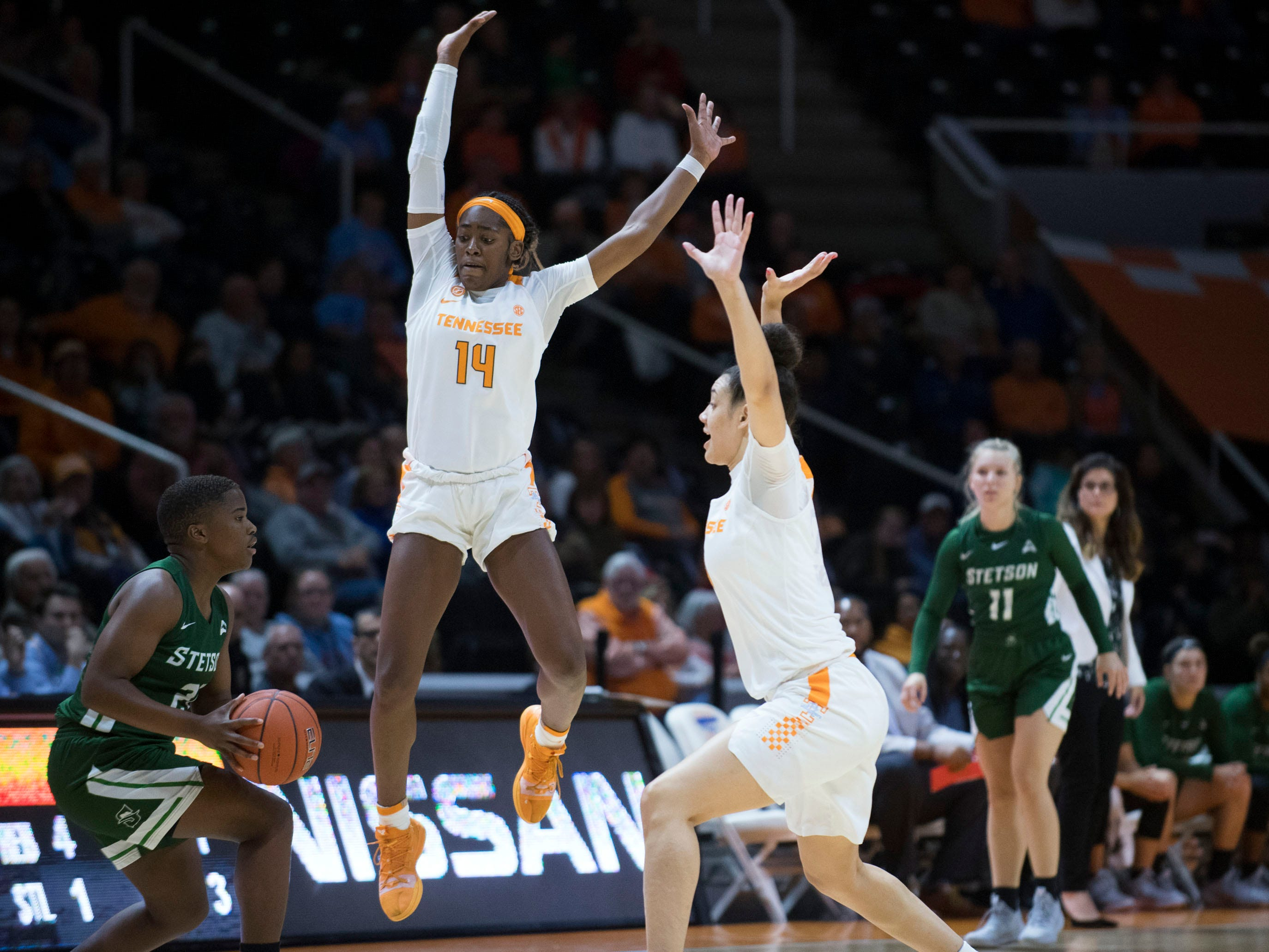 Tennessee's Zaay Green (14) and Mimi Collins (4) defend Stetson's Mackenzie Davis (21) at Thompson-Boling Arena on Wednesday, December 5, 2018.