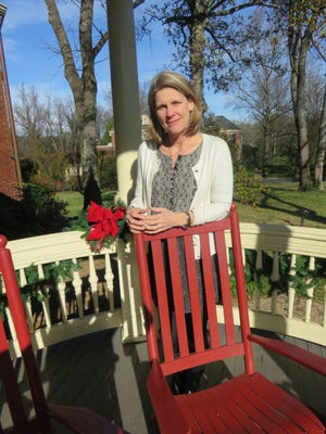 New Knox Heritage director of engagement and estate manager Annette Brun stands on the porch of the Historic Westwood home on Dec. 3