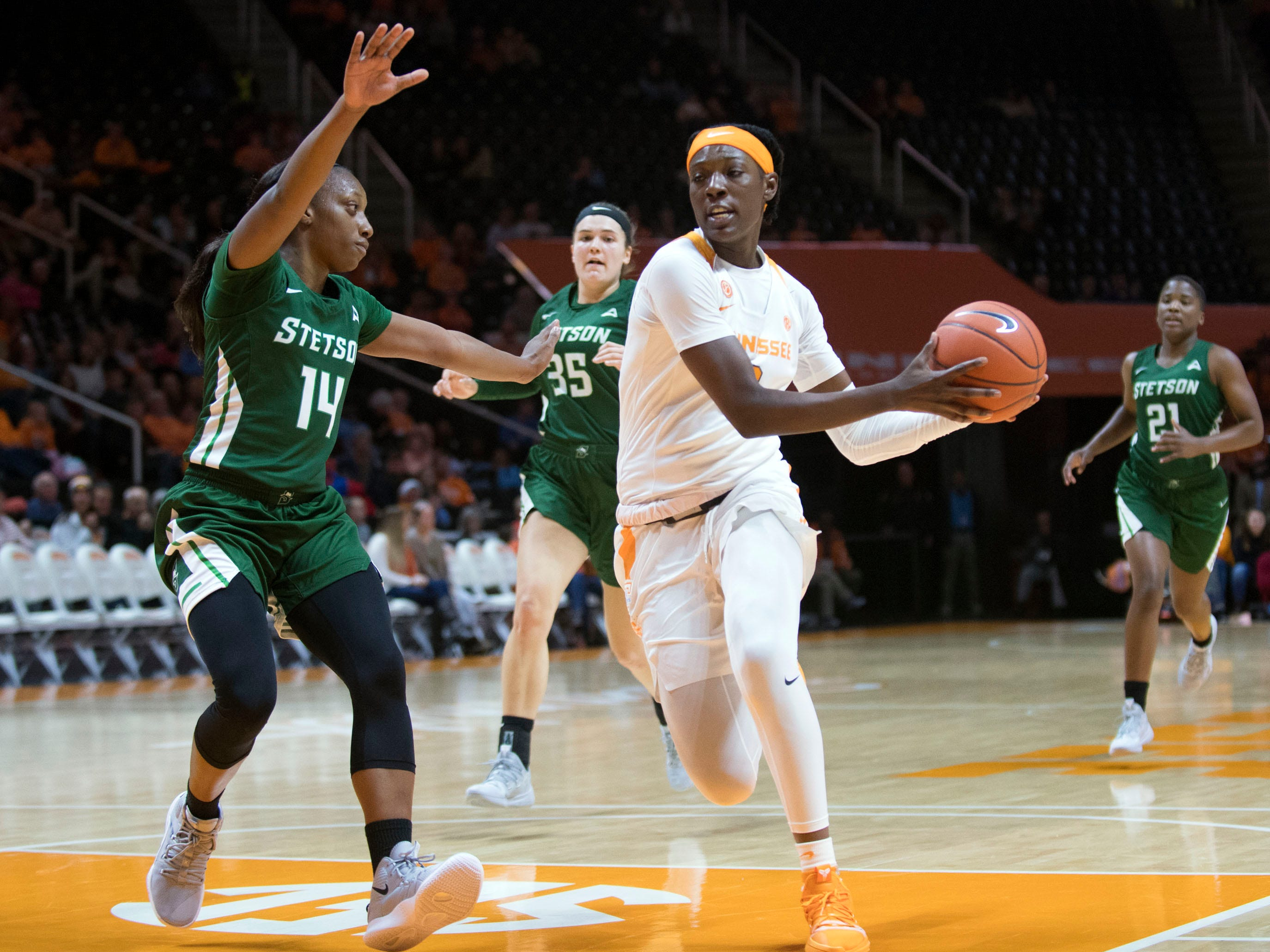 Tennessee's Rennia Davis (0) makes her way to the basket while defended by Stetson's Jon'Nita Henry (14) at Thompson-Boling Arena on Wednesday, December 5, 2018.