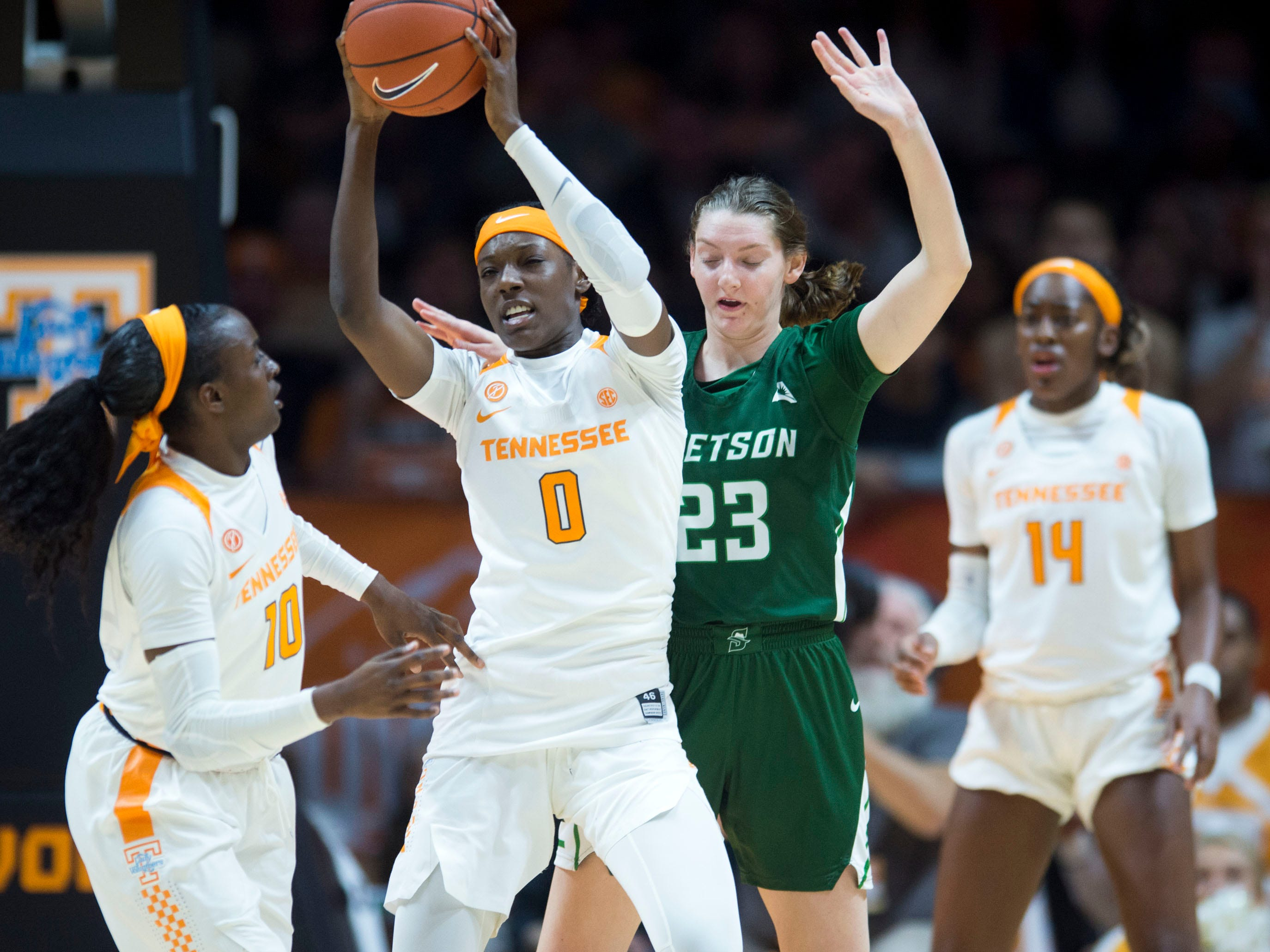 Tennessee's Rennia Davis (0) gets the ball away from Stetson's Megan Vincent (23) at Thompson-Boling Arena on Wednesday, December 5, 2018.
