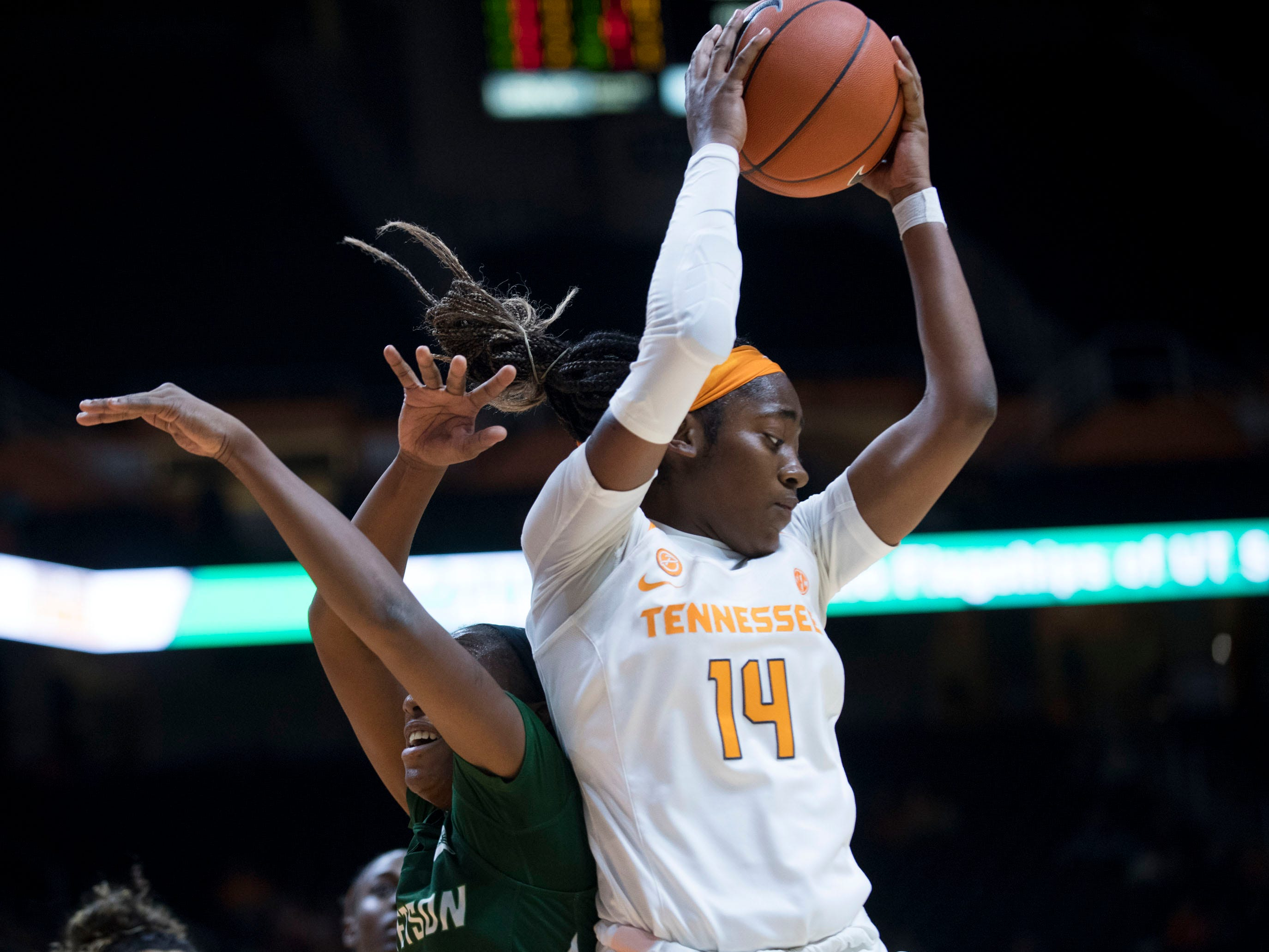 Tennessee's Zaay Green (14) gets the rebound over Stetson's Jon'Nita Henry (14) on Wednesday, December 5, 2018.