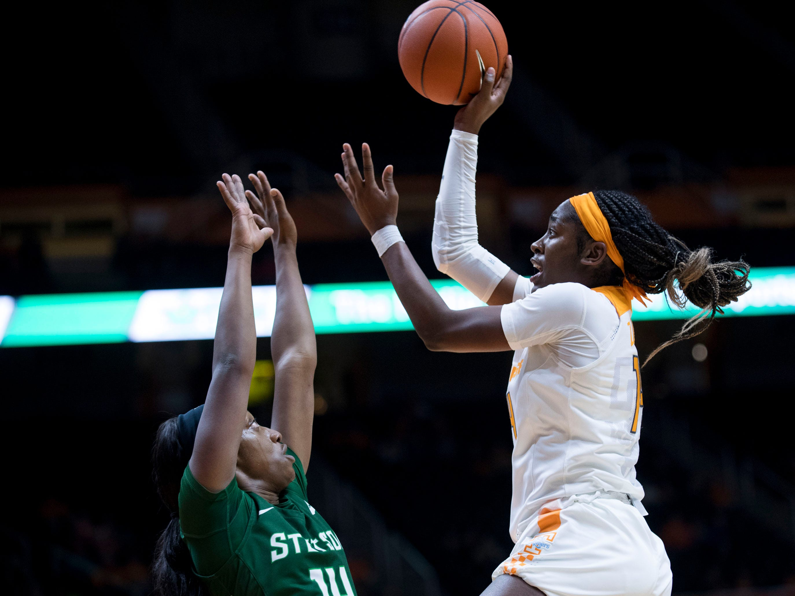Tennessee's Zaay Green (14) attempts to score while defended by Stetson's Jon'Nita Henry (14) on Wednesday, December 5, 2018.