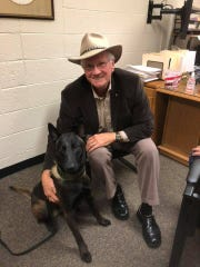 Hamblen County Sheriff Esco Jarnagin poses with K-9 deputy Nexy who apprehended the suspect in a car chase that allegedly fired a gun at a pursuing deputy on Thursday.