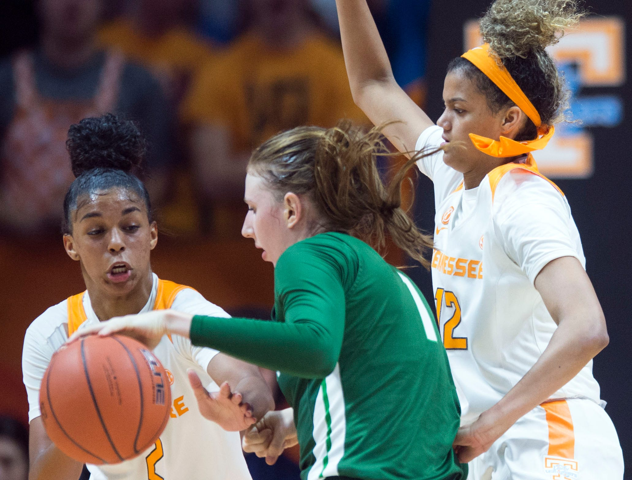 Tennessee's Evina Westbrook (2) and Rae Burrell (12) defend Stetson's Sarah Sagerer (1) on Wednesday, December 5, 2018.