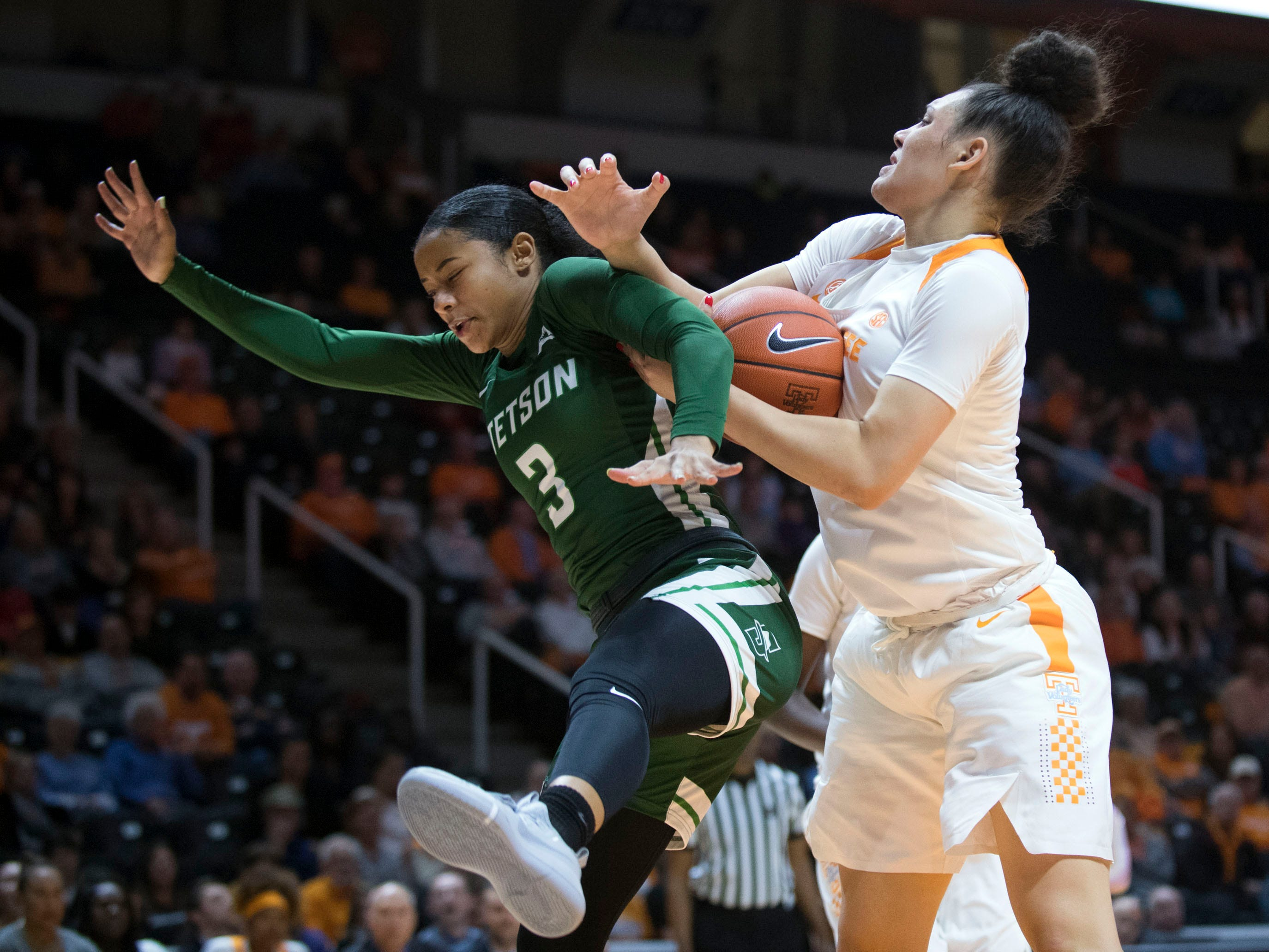 Tennessee's Mimi Collins (4) collides with Stetson's Bianca Fizouaty (3) on Wednesday, December 5, 2018.