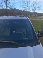A Hamblen County Deputy's vehicle is shown after being struck by a bullet during a car chase on Thursday.