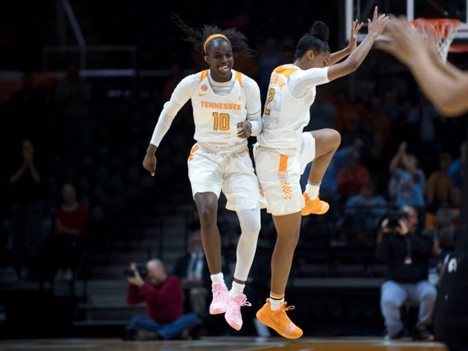 Tennessee's Meme Jackson (10) and Evina Westbrook (2) celebrate during the game against Stetson at Thompson-Boling Arena on Wednesday, December 5, 2018.