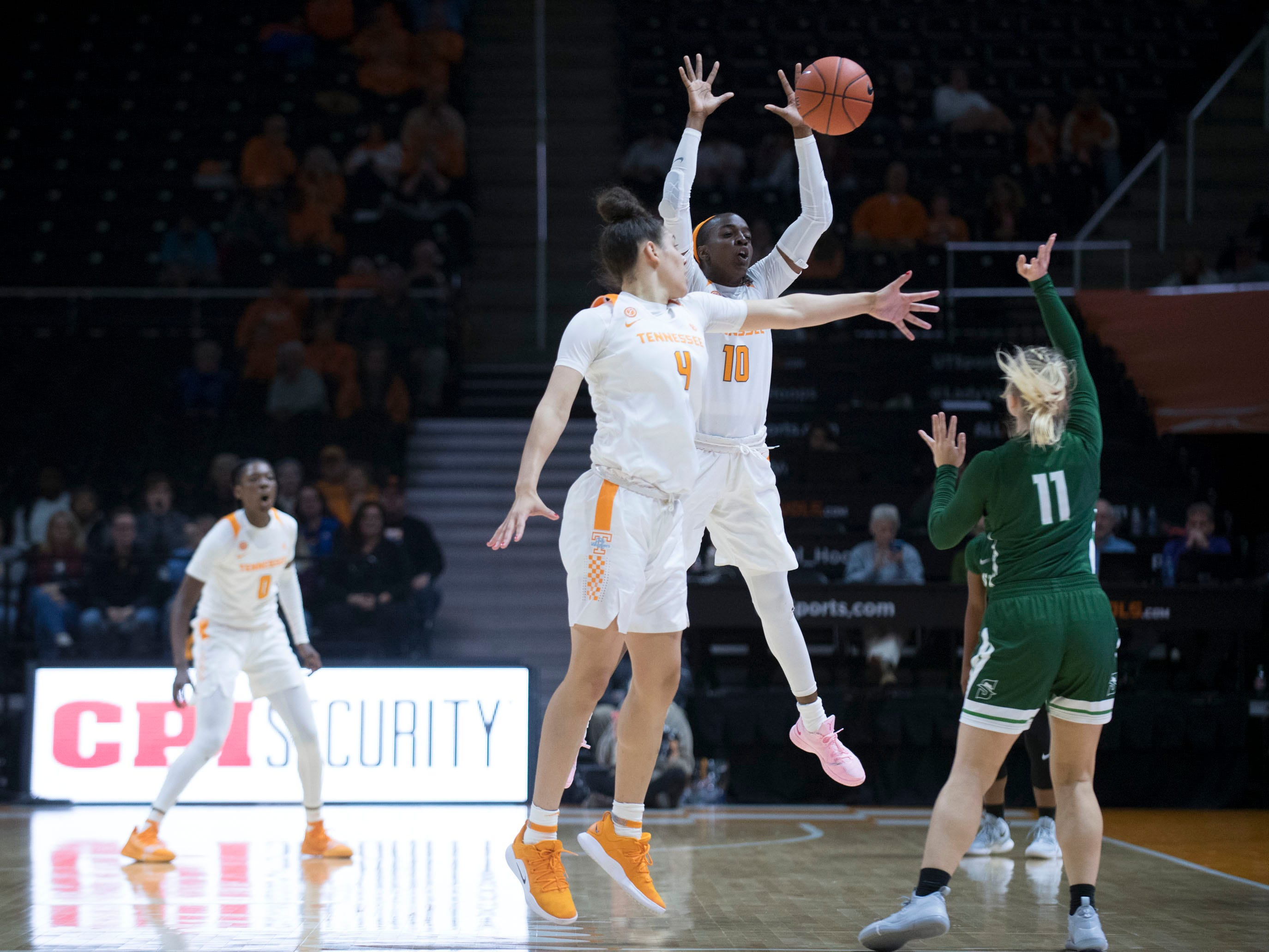 Tennessee's Meme Jackson (10) blocks a pass by Stetson's Addi Walters (11) on Wednesday, December 5, 2018.