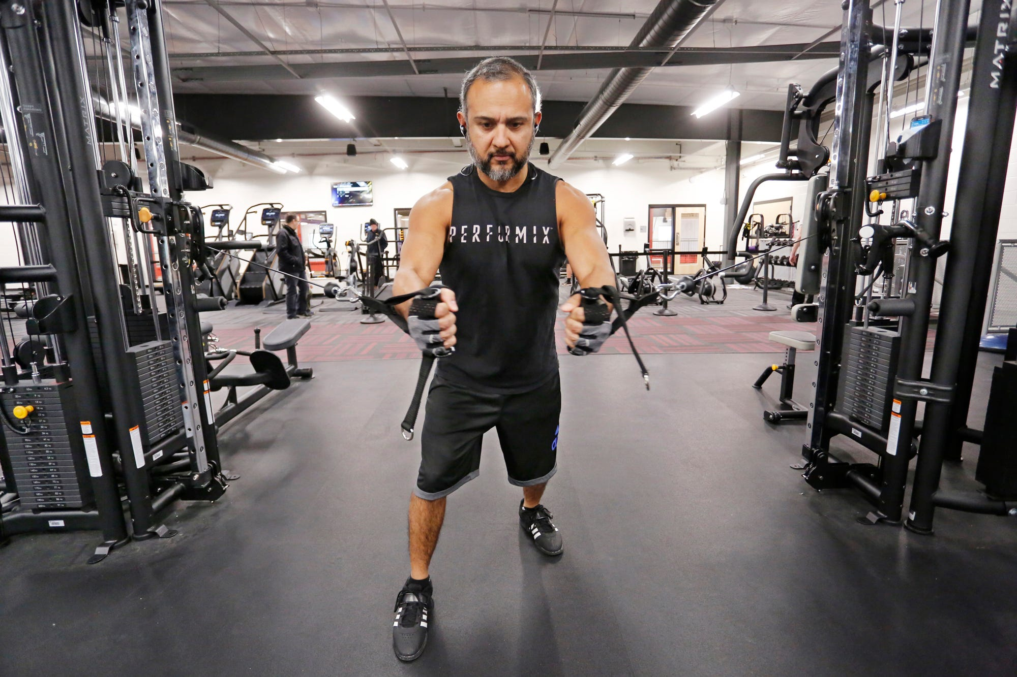 Joe Garcia works out with a cable cross over inside the James and Cari Gothard Wellness Center Thursday, December 6, 2018, at the new Lafayette Family YMCA, 3001 S. Creasy Lane in Lafayette. Garcia lives and works in Frankfort, but says he can get to the YMCA in quick 20 minute drive. The facility celebrated its grand opening Thursday.