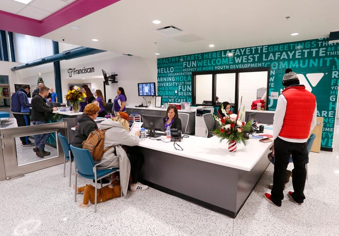 Guests sign up for memberships Thursday, December 6, 2018, at the new Lafayette Family YMCA, 3001 S. Creasy Lane in Lafayette. The facility celebrated its grand opening Thursday.