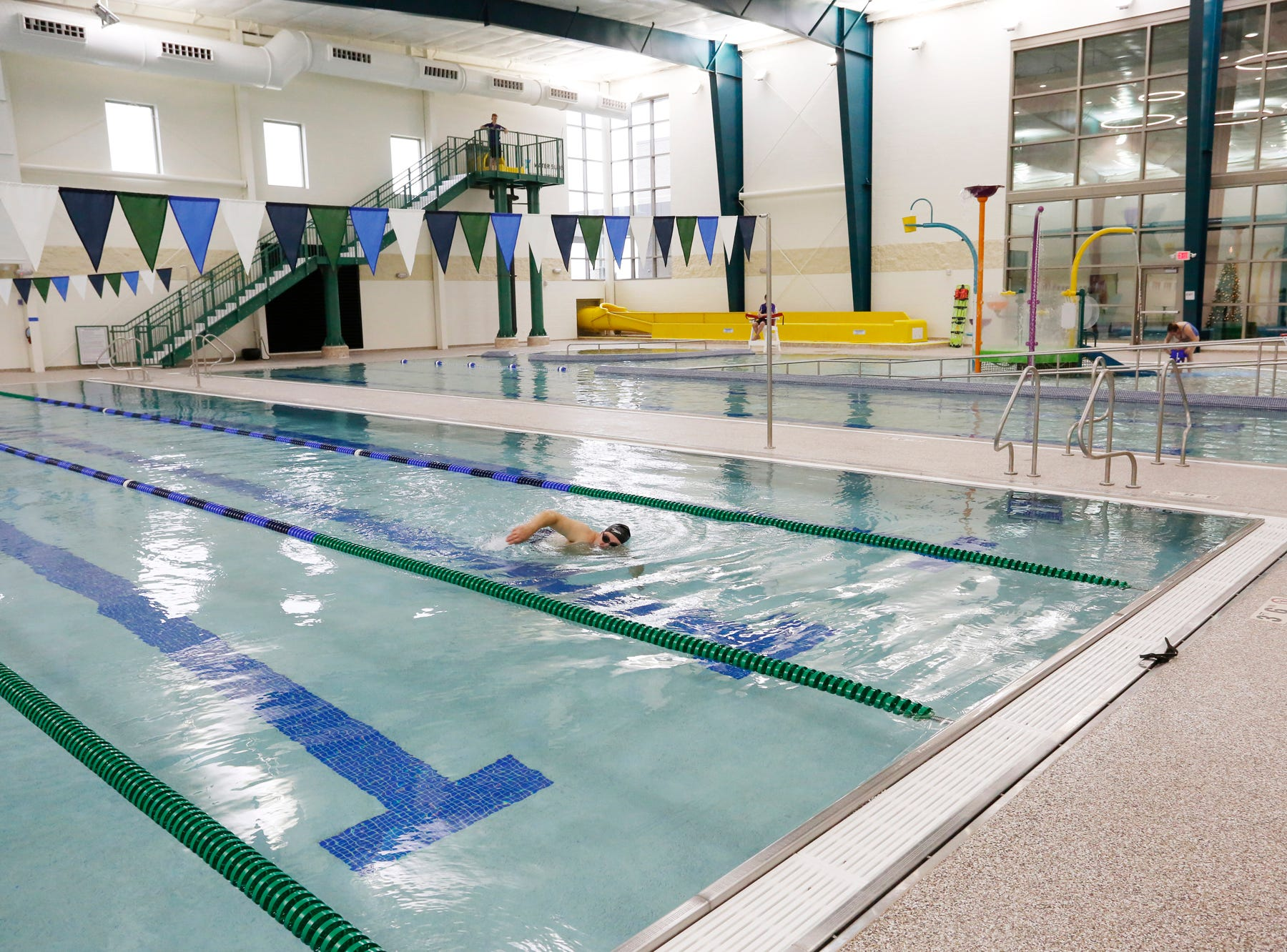 A swimmer enjoys the lap lanes Thursday, December 6, 2018, at the new Lafayette Family YMCA, 3001 S. Creasy Lane in Lafayette. The facility celebrated its grand opening Thursday.