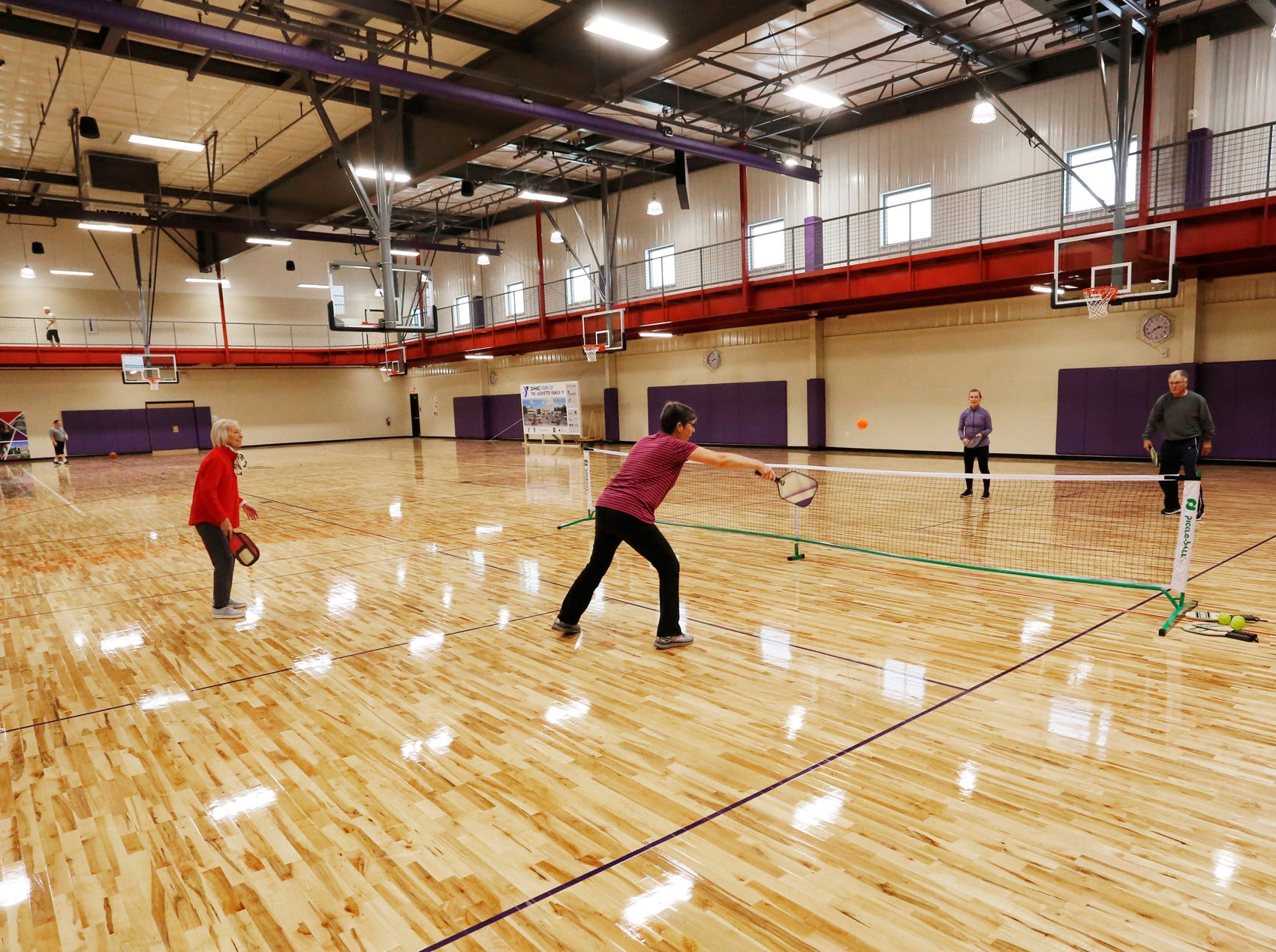 Members play pickle ball inside the gymnasium Thursday, December 6, 2018, at the new Lafayette Family YMCA, 3001 S. Creasy Lane in Lafayette. The facility celebrated its grand opening Thursday.