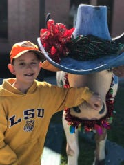 Drake, 8, of Vinton, Louisiana, is a huge LSU fan. He is fighting terminal cancer.