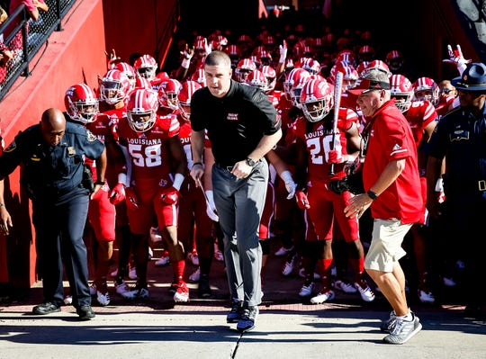 ULL Coach Billy Napier leads his team onto the field before the football game between ULL and New Mexico State University at Cajun Field in Lafayette, Louisiana on October 13, 2018.