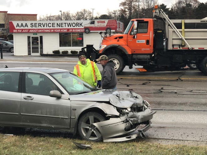 A car was involved in a three-vehicle crash on Grand River Avenue near Lawson Road in Genoa Township Thursday, Dec. 6, 2018.