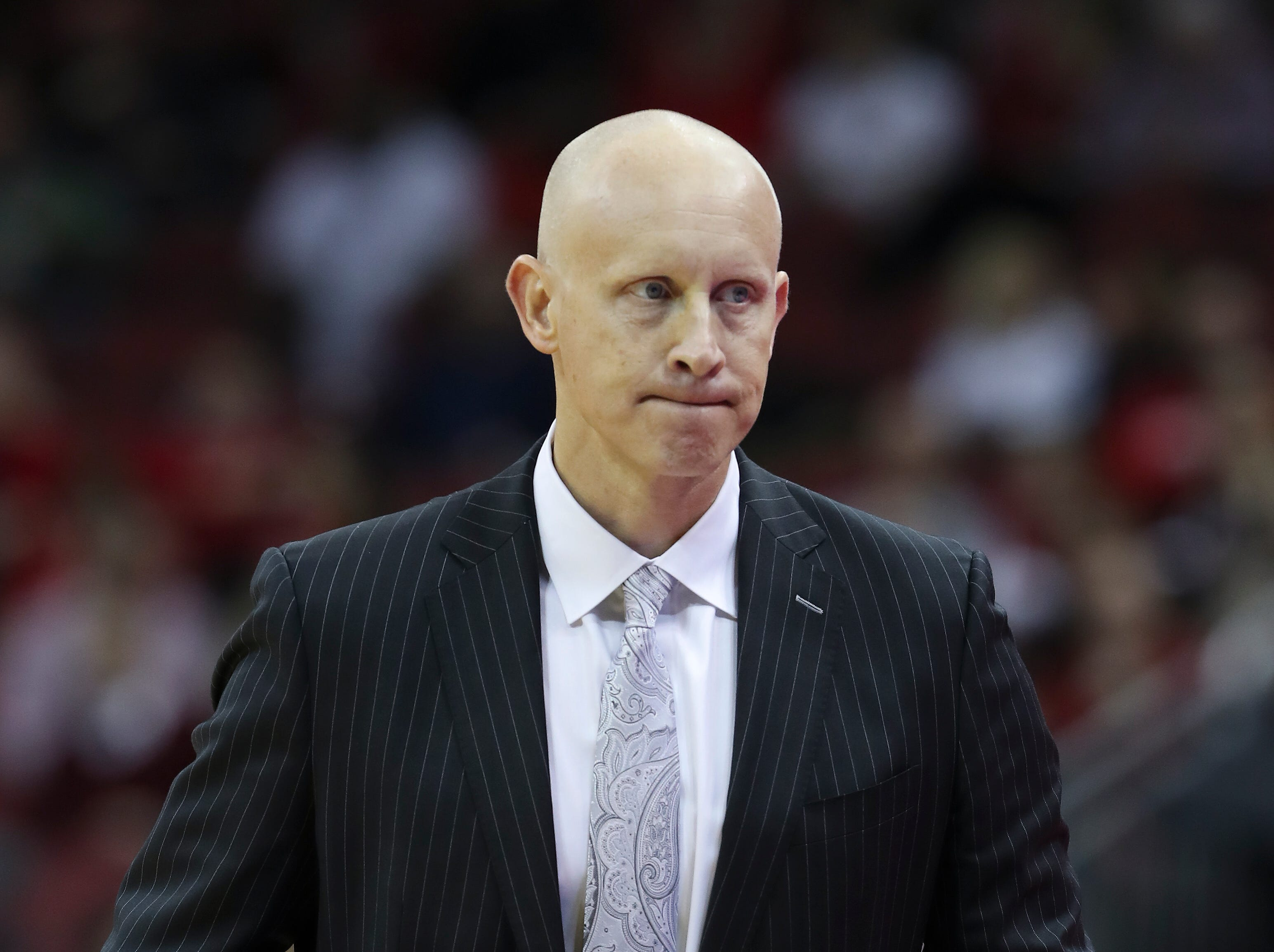 Louisville's head coach Chris Mack watches play against Central Arkansas during their game at the Yum Center.  