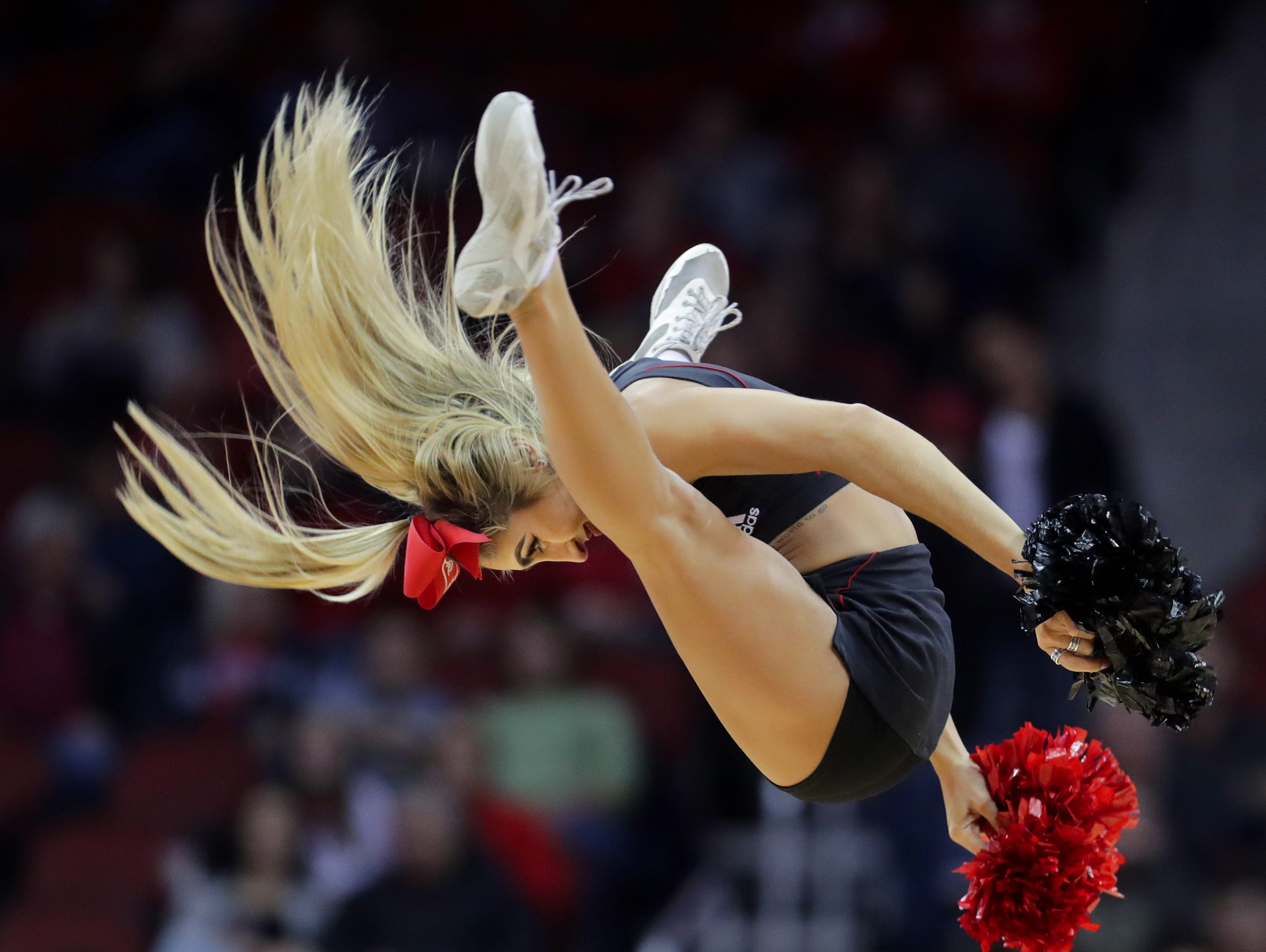 Louisville cheerleaders entertain the crowd during a timeout. 