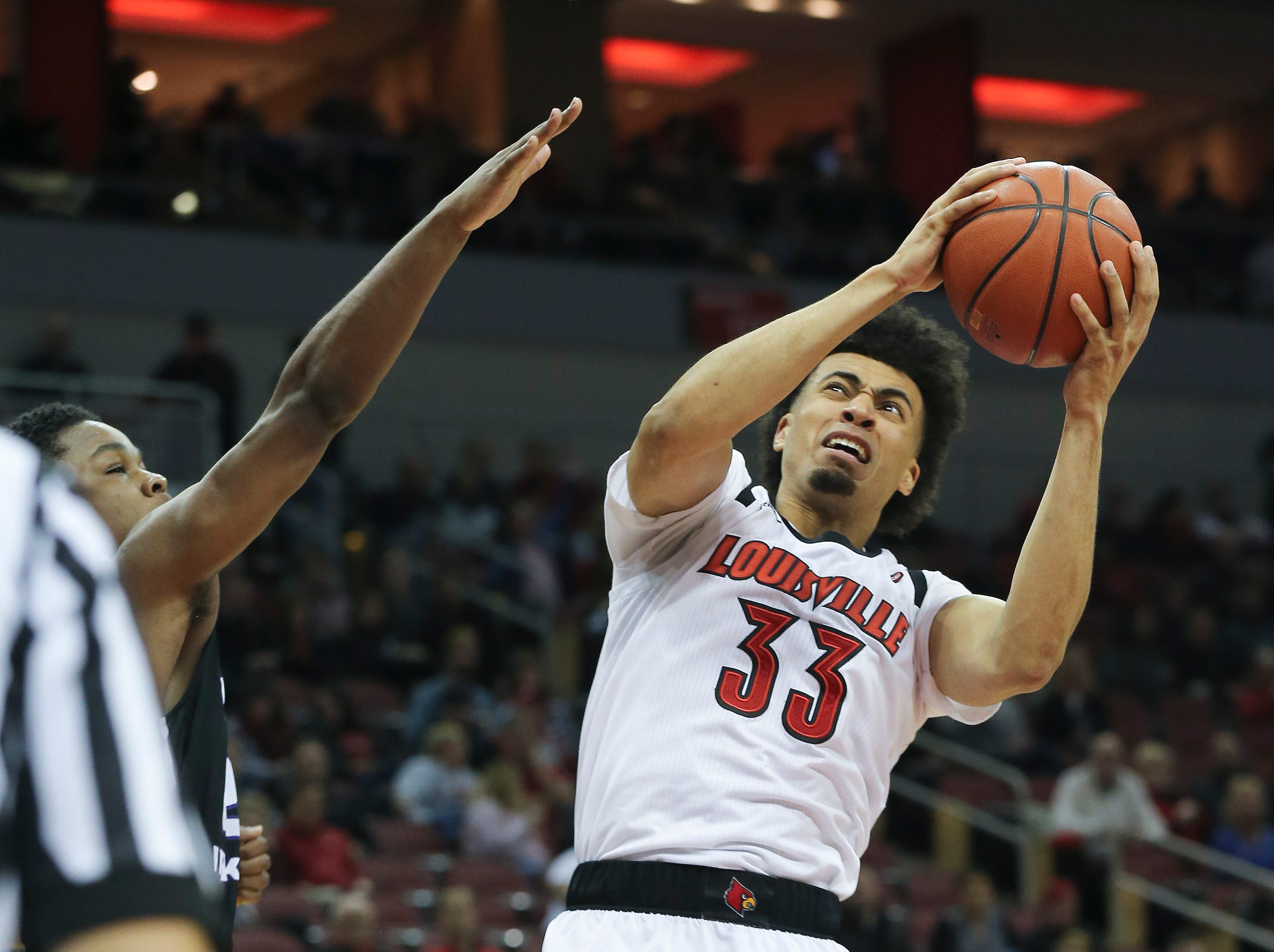 Louisville's Jordan Nwora (33) drives to the basket against Central Arkansas during their game at the Yum Center.  