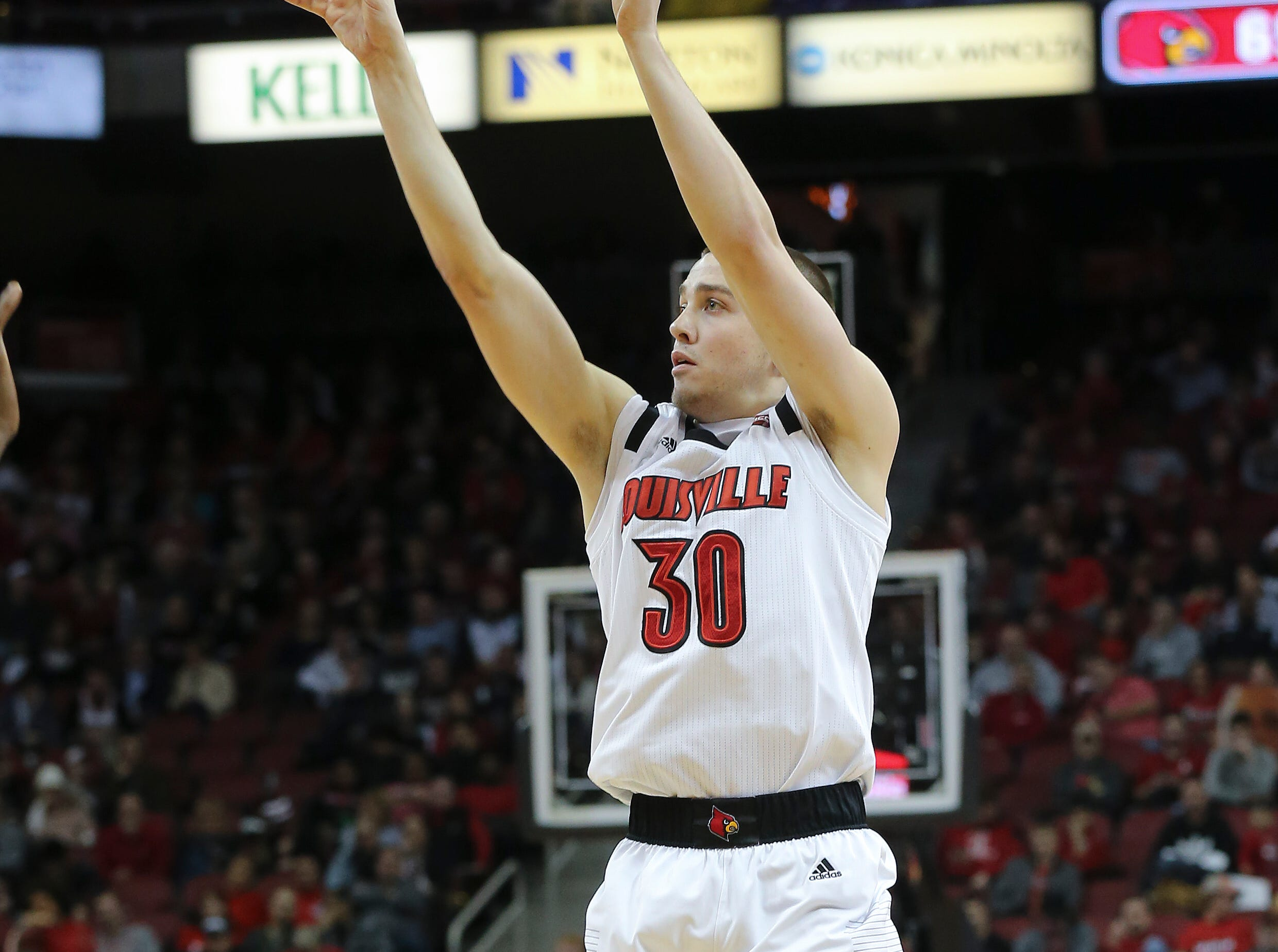Louisville's Ryan McMahon (30) shoots against Central Arkansas during their game at the Yum Center.  