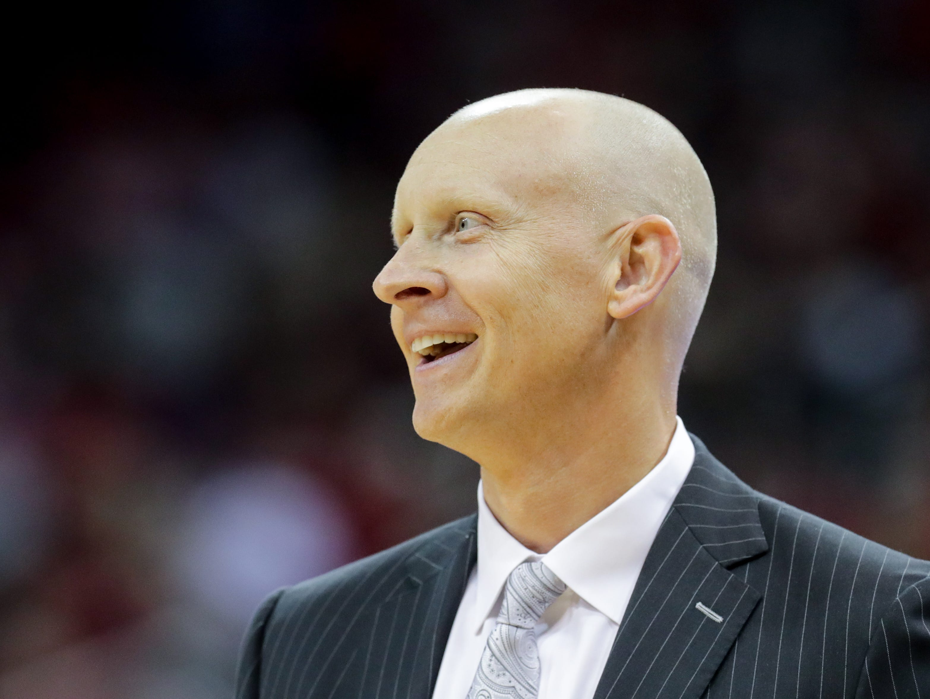 Louisville's Chris Mack coaches during play. 
