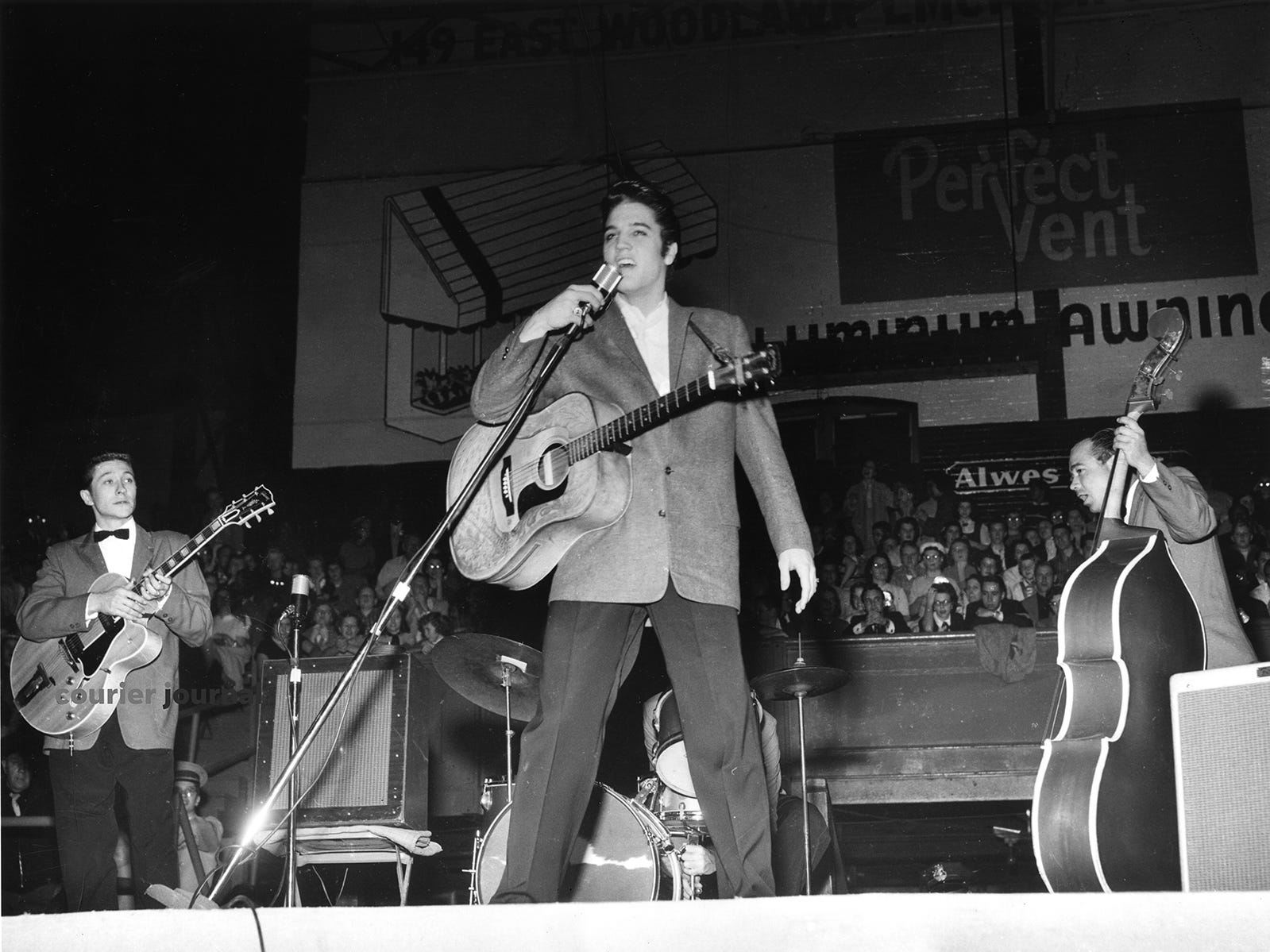Elvis Presley performs at the Armory in Louisville.  Nov. 25, 1956.