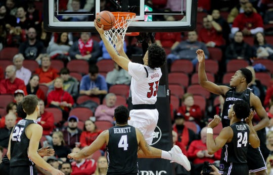 Louisville's Jordan Nwora with gets two surrounded by Central Arkansas defenders. Dec. 5, 2018