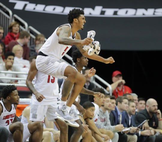 Louisville's Malik Williams celebrates a teammate scoring. Dec. 5, 2018