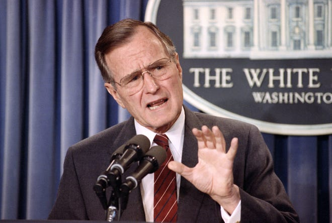 President George H.W. Bush speaks during a news conference in the White House briefing room in Washington on March 13, 1990.